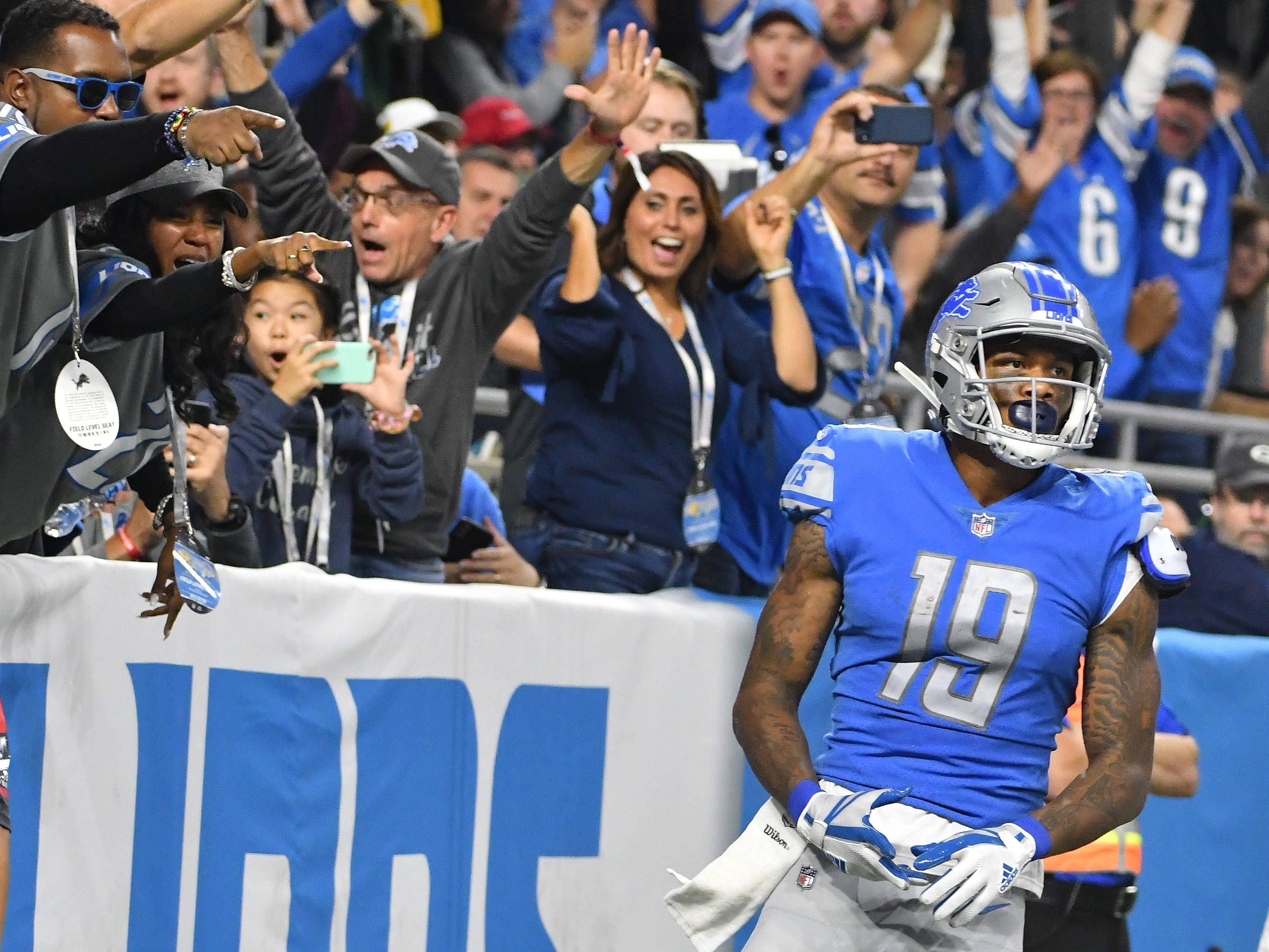 Fans celebrate as Lions wide receiver Kenny Golladay puts another 6 points on the board, this time in the fourth quarter.