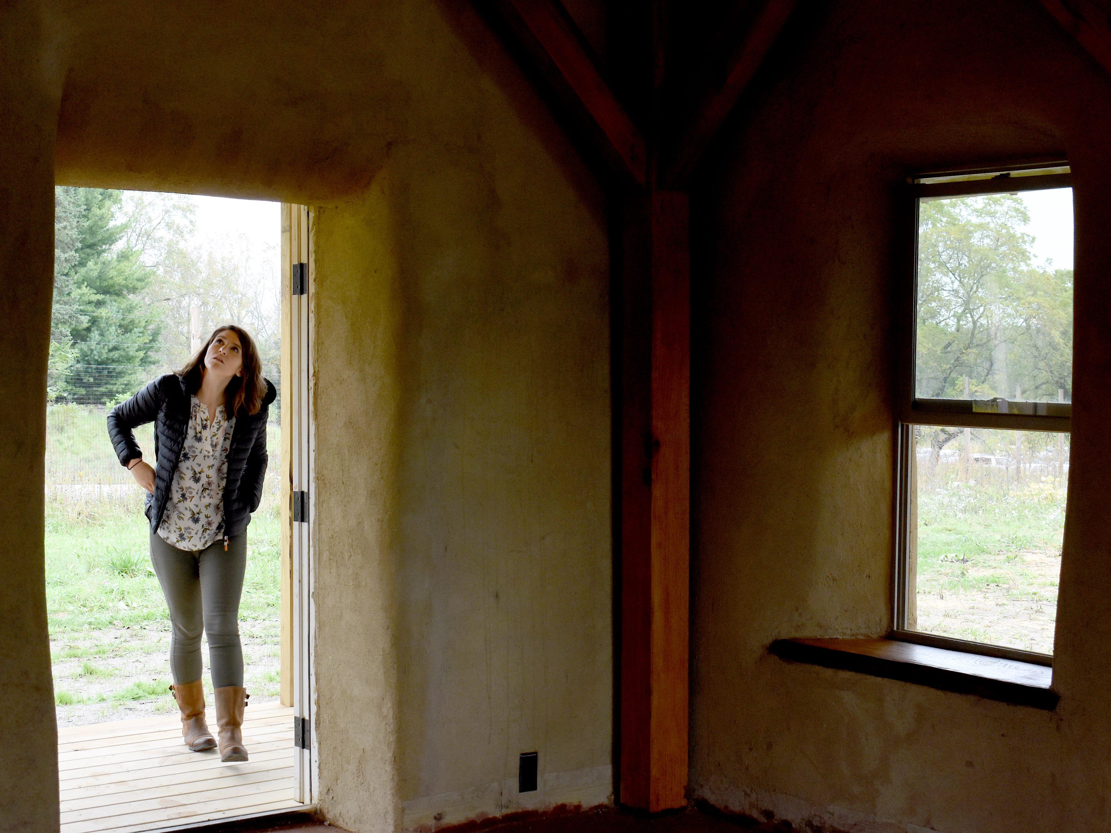 UM Architecture alumnus Loran Newman, 27, of Chicago, examines the Straw Bale Building.