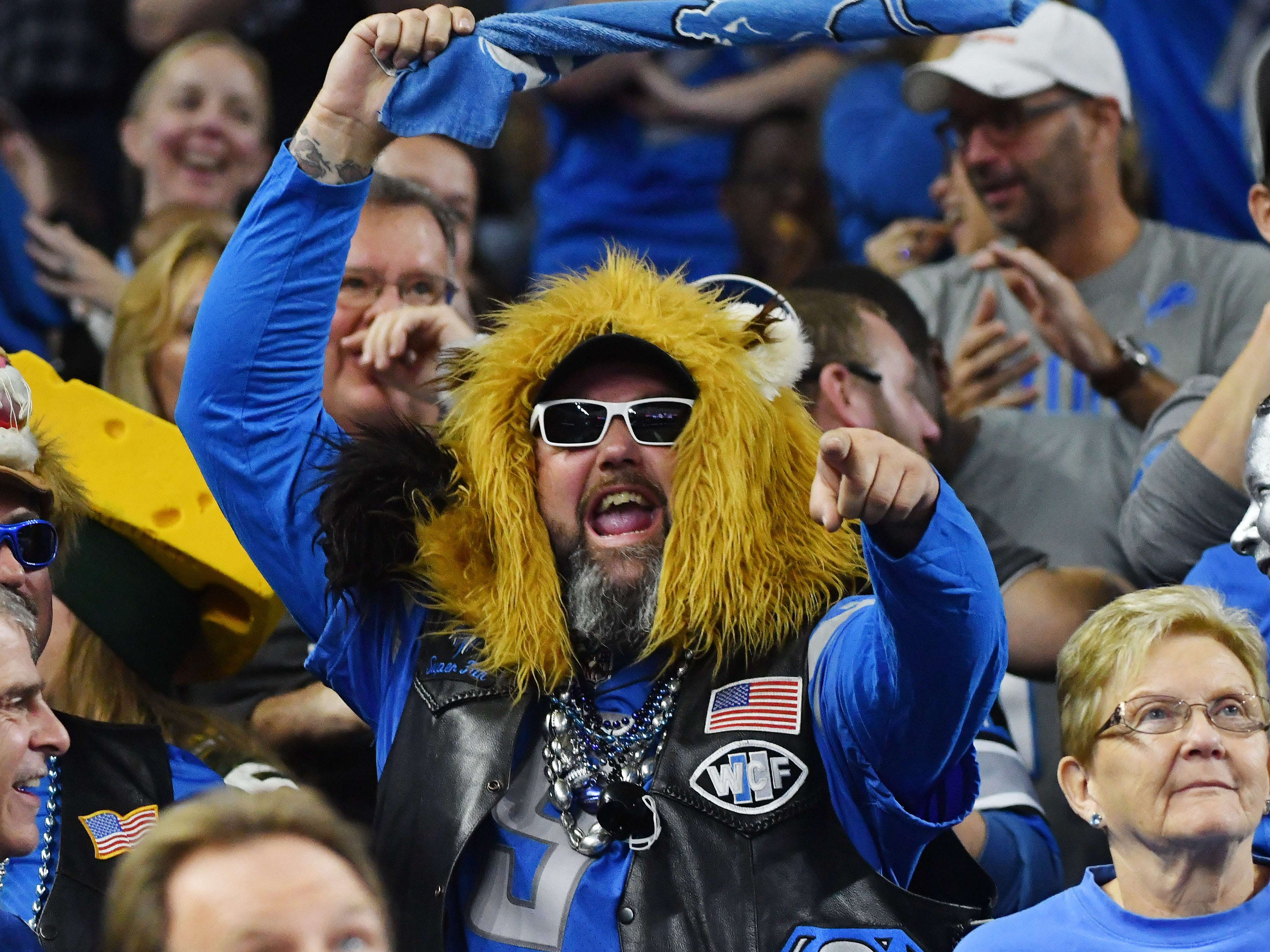 Lions fans enjoy the first half shutout of the Packers, 24-0.