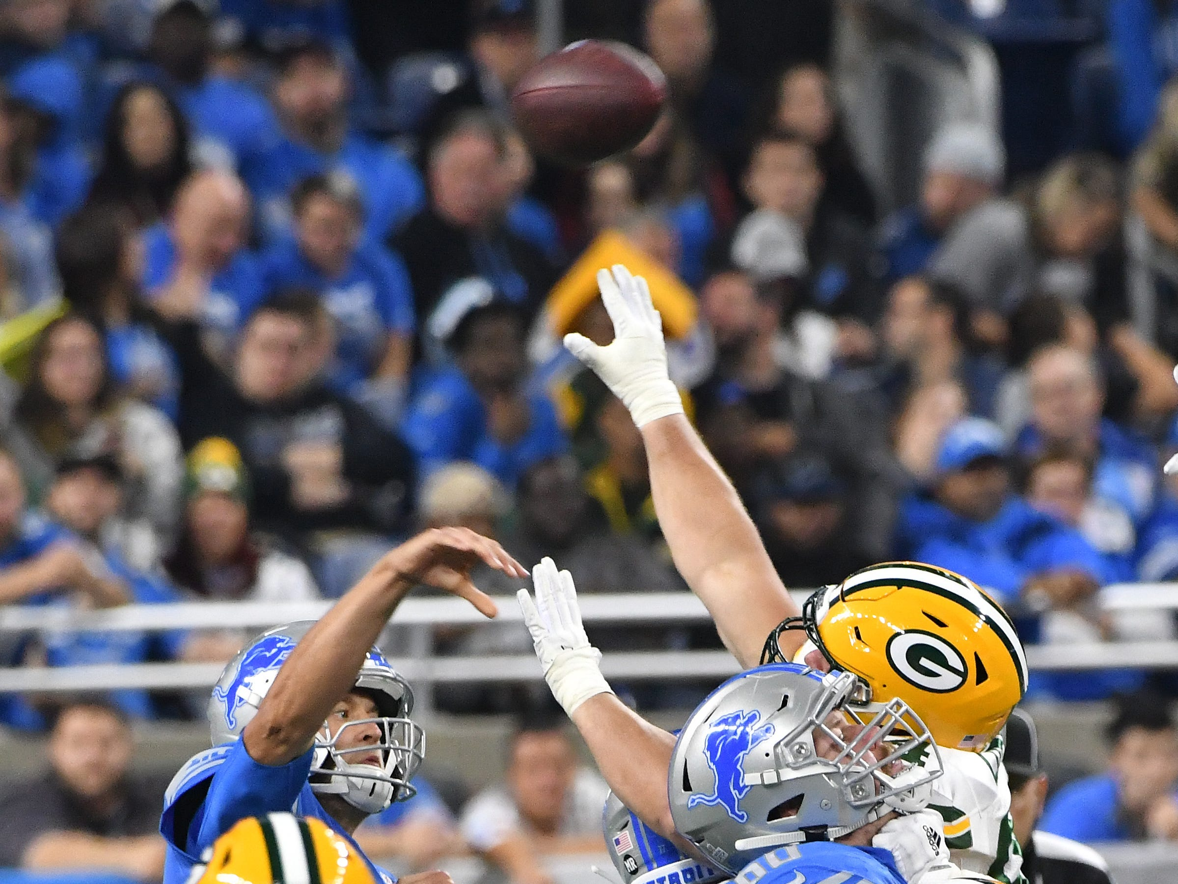 Lions quarterback Matthew Stafford has to get the ball over the Packers defense to get the ball to wide receiver Kenny Golladay on a long first down reception in the first quarter.