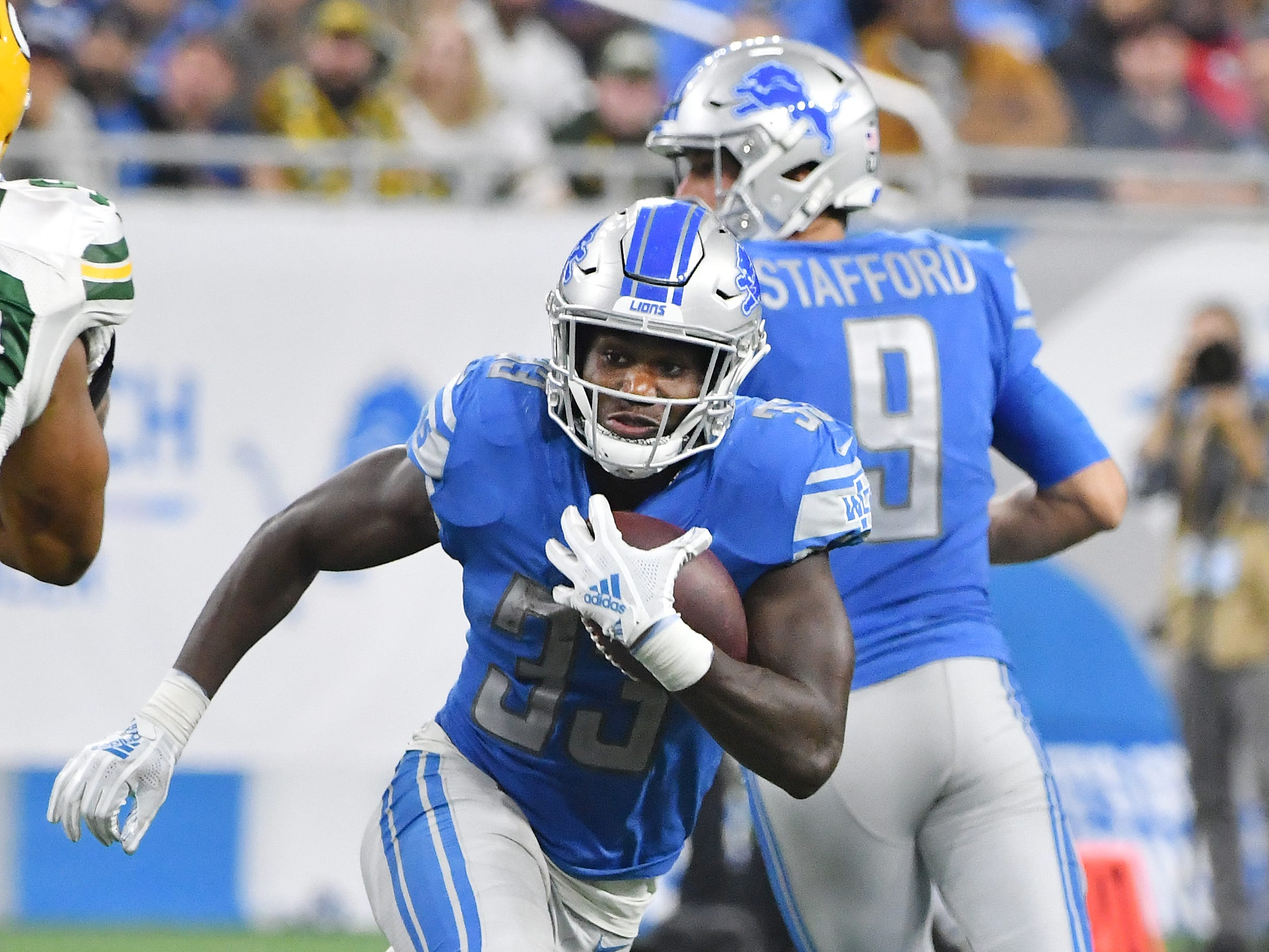 Lions running back Keryon Johnson takes the ball up field after the handoff from quarterback Matthew Stafford in the fourth quarter.