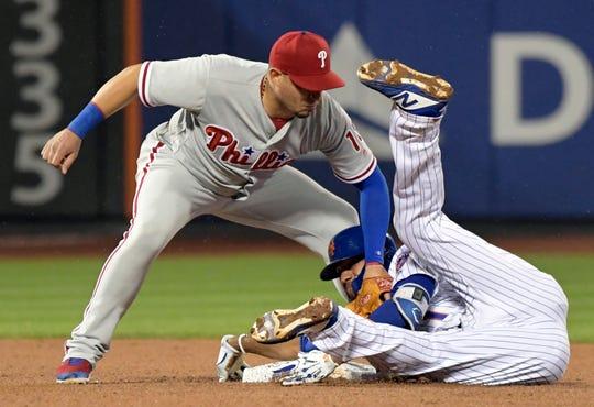 Philadelphia Phillies shortstop Asdrubal Cabrera (left) hit 23 home runs between two teams last season, but his defense leaves much to be desired.