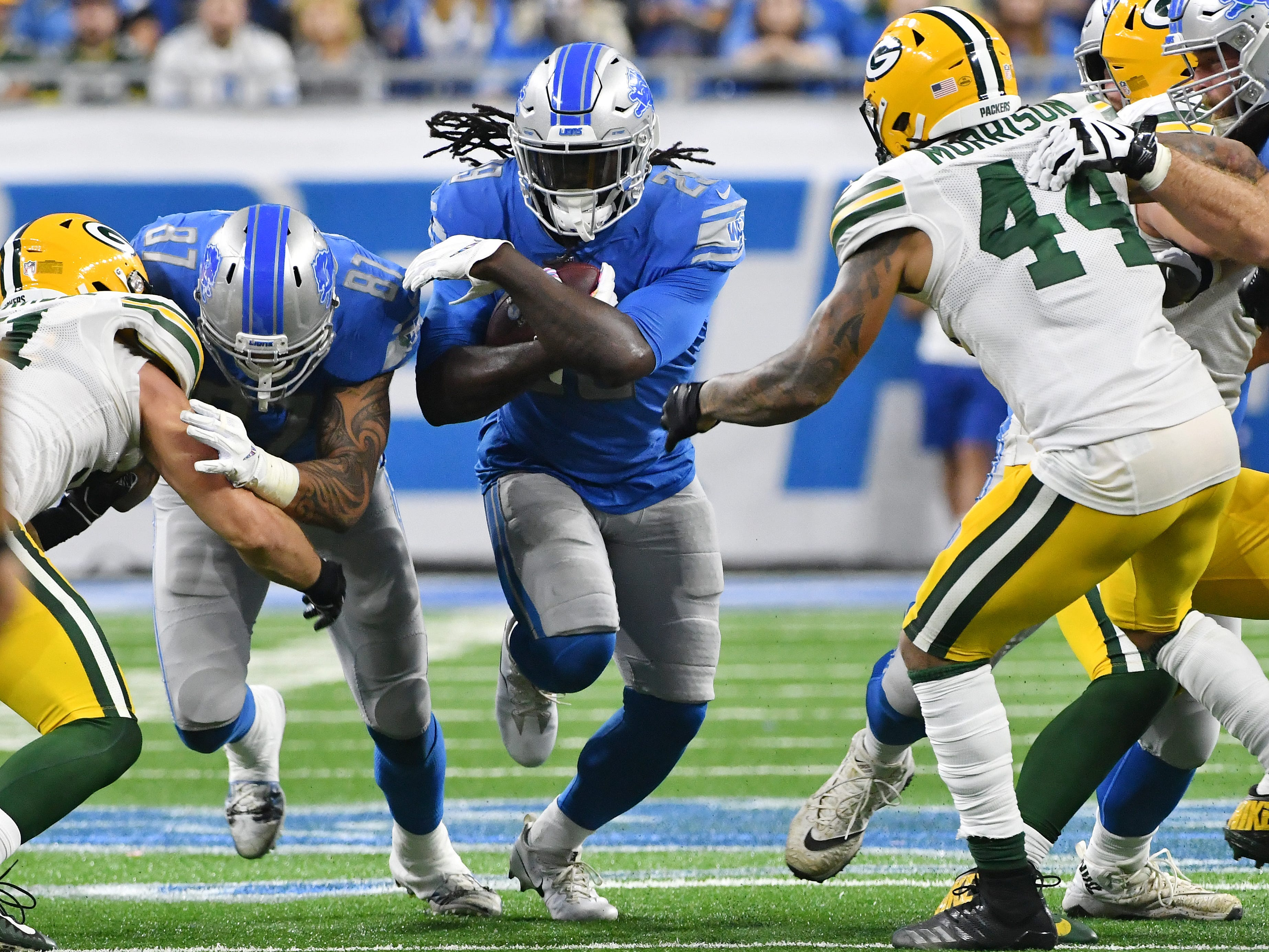 Lions running back LeGarrette Blount finds a whole in the Packers defensive line in the fourth quarter.