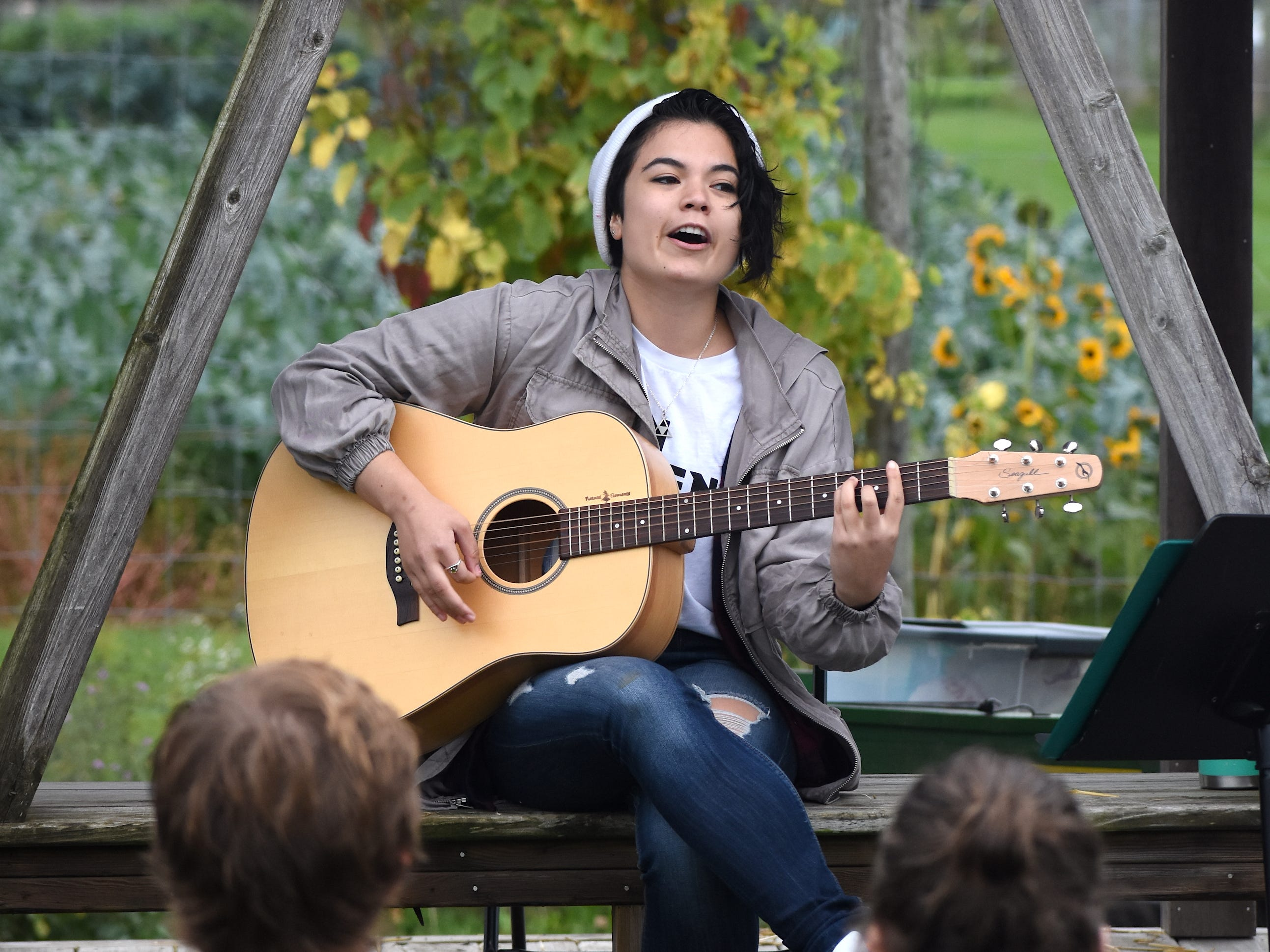 Guitarist/ singer Jasmine Purtell entertains guests with a little music.