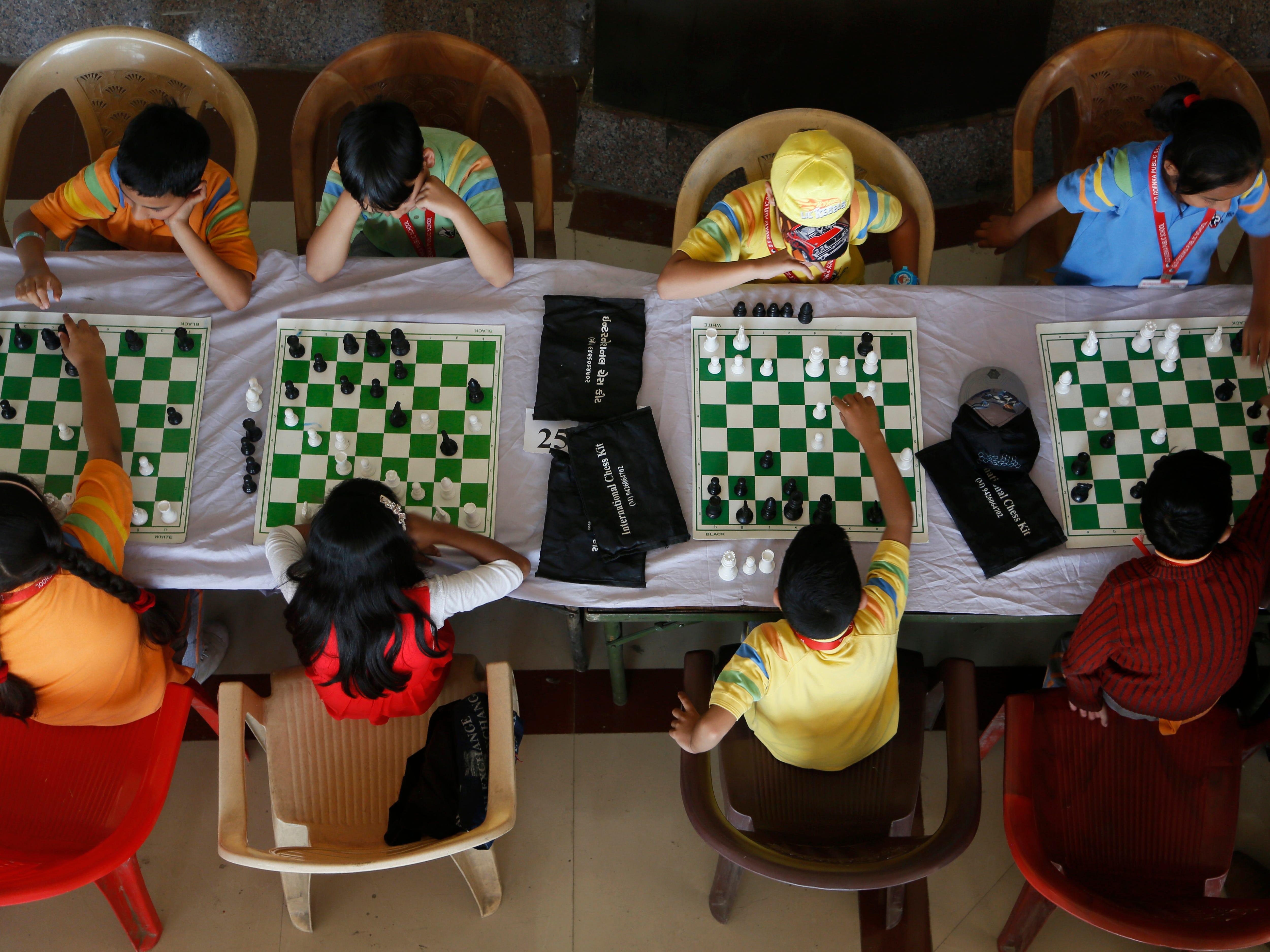 Kashmiri school children take part in a Chess championship in Srinagar, Indian controlled Kashmir, Sunday, Oct. 7, 2018.