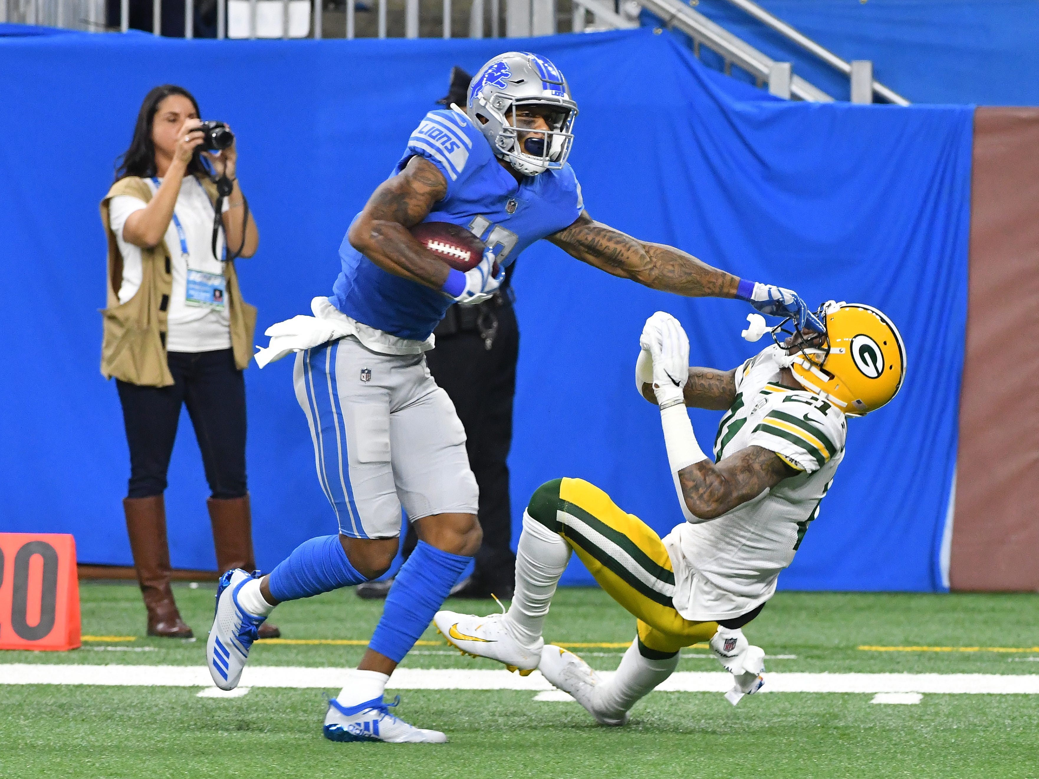 Lions' Kenny Golladay runs after a long reception down the sidelines, stiff arming Packers' Ha Ha Clinton-Dix in the first quarter.