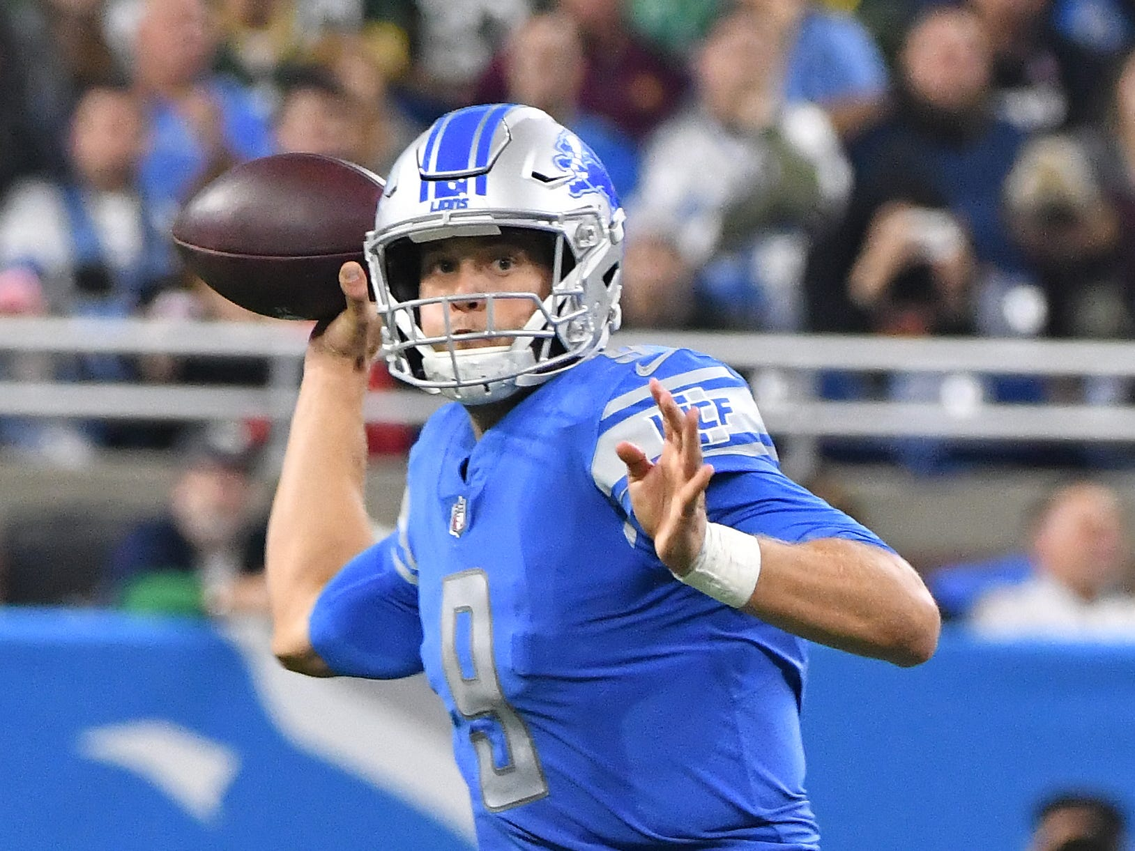 Lions quarterback Matthew Stafford looks up field for an open receiver in the third quarter.
