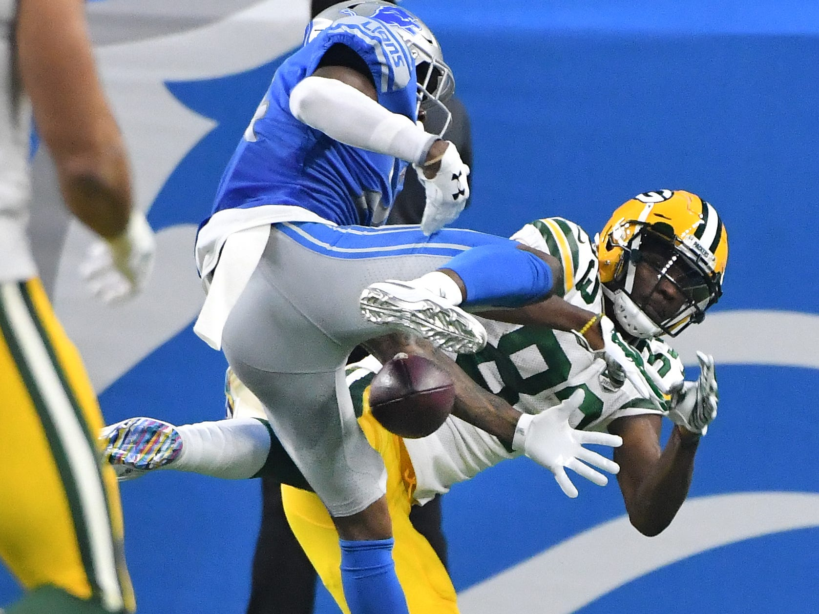 Lions' Nevin Lawson breaks up a pass in the end zone intended for Packers' Marquez Valdes-Scantling in the first quarter.