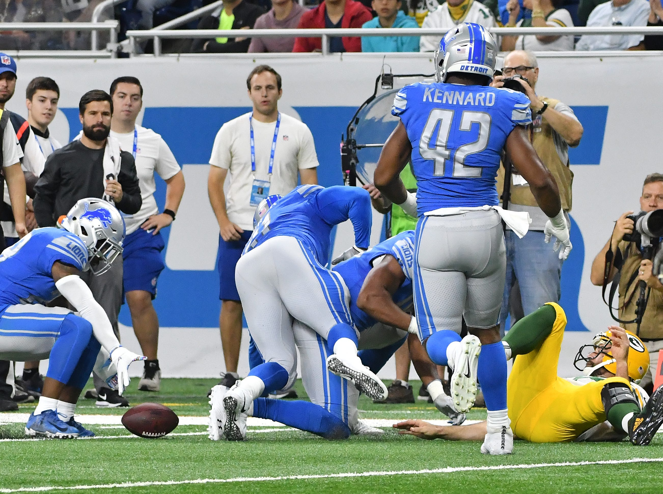 Packers' Aaron Rodgers fumbles the ball with a swat of the ball by Lions' Romeo Okwara, with Detroit recovering,  in the first quarter.