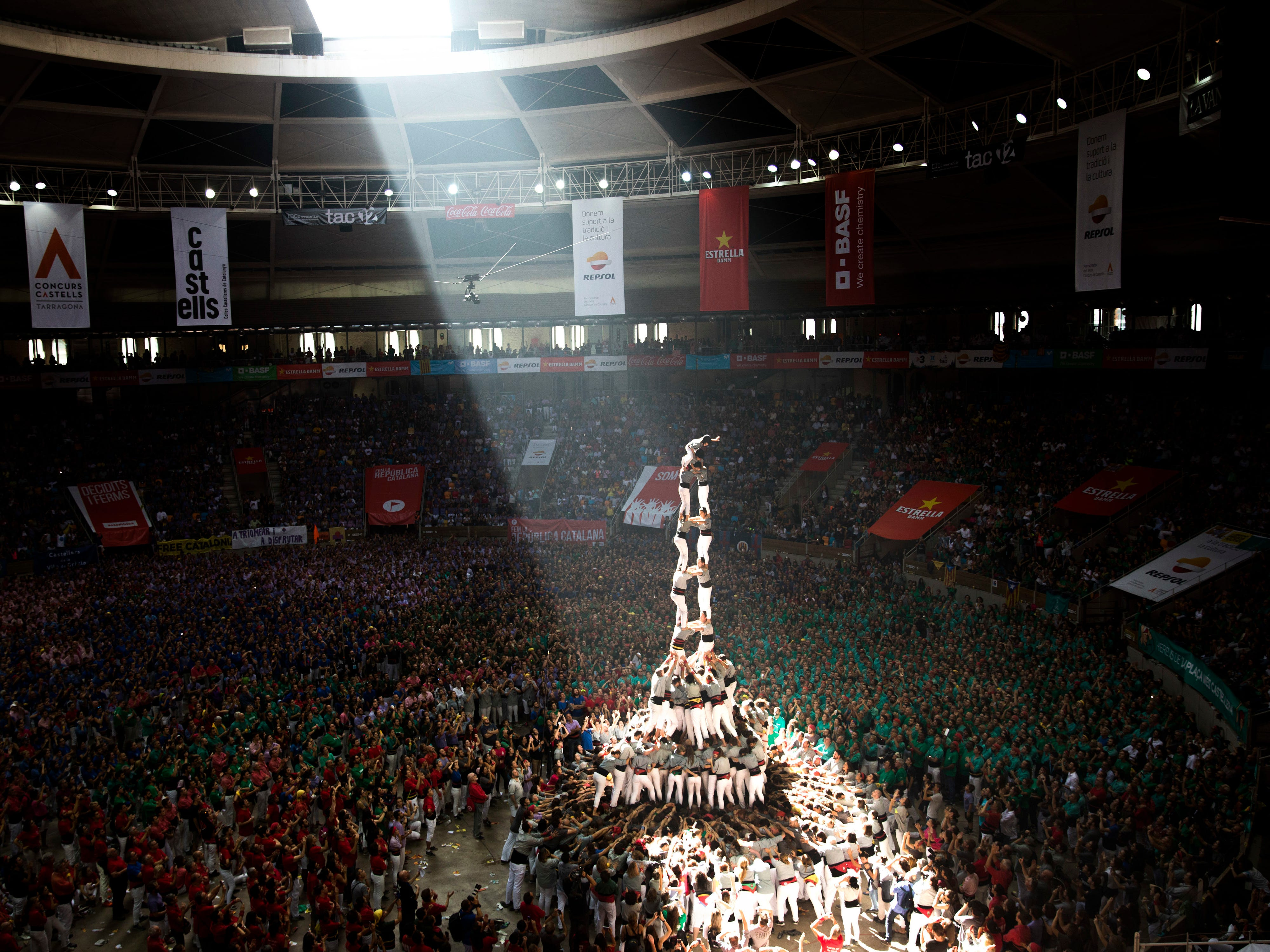 """Members of """"Castellers de Sants"""" complete their human tower during the 27th Human Tower Competition in Tarragona, Spain, Sunday, Oct. 7, 2018. The tradition of building human towers or """"castells"""" dates back to the 18th century and takes place during festivals in Catalonia, where """"colles"""" or teams compete to build the tallest and most complicated towers. """"Castells"""" were declared by UNESCO one of the Masterpieces of the Oral and Intangible Heritage of Humanity."""