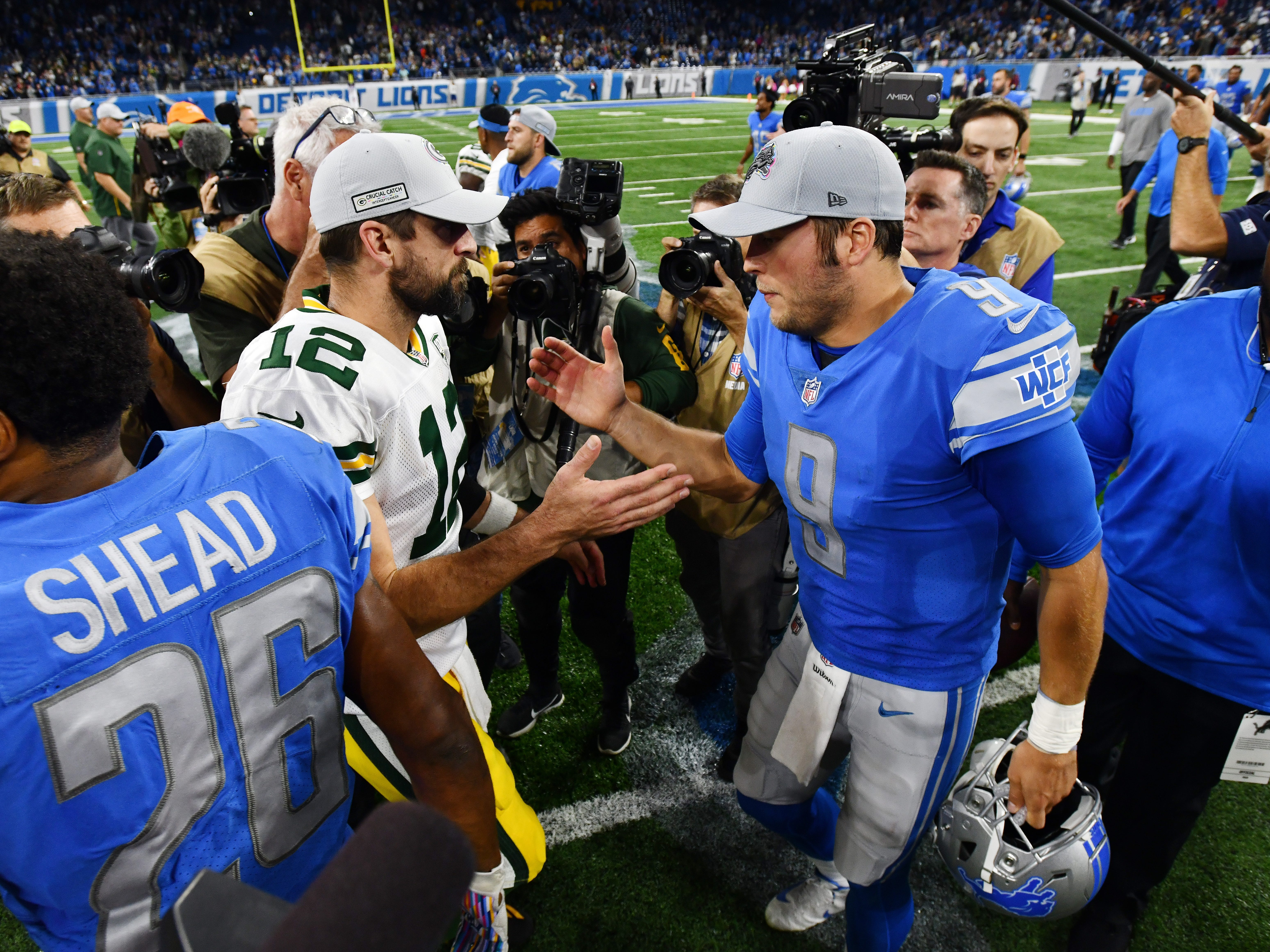 Packers quarterback Aaron Rodgers and Lions quarterback Matthew Stafford meet on the field after the 31-23 Detroit victory.