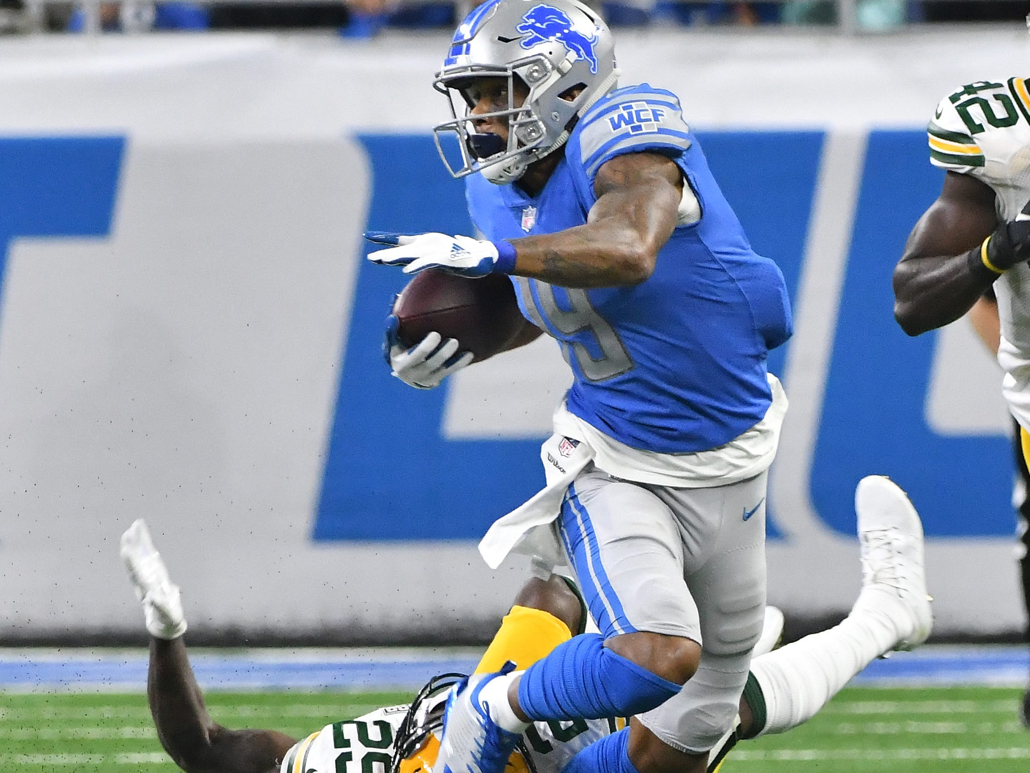 Lion's Kenny Golladay scrambles away from Packers' Kentrell Brice after a reception in the second  quarter.