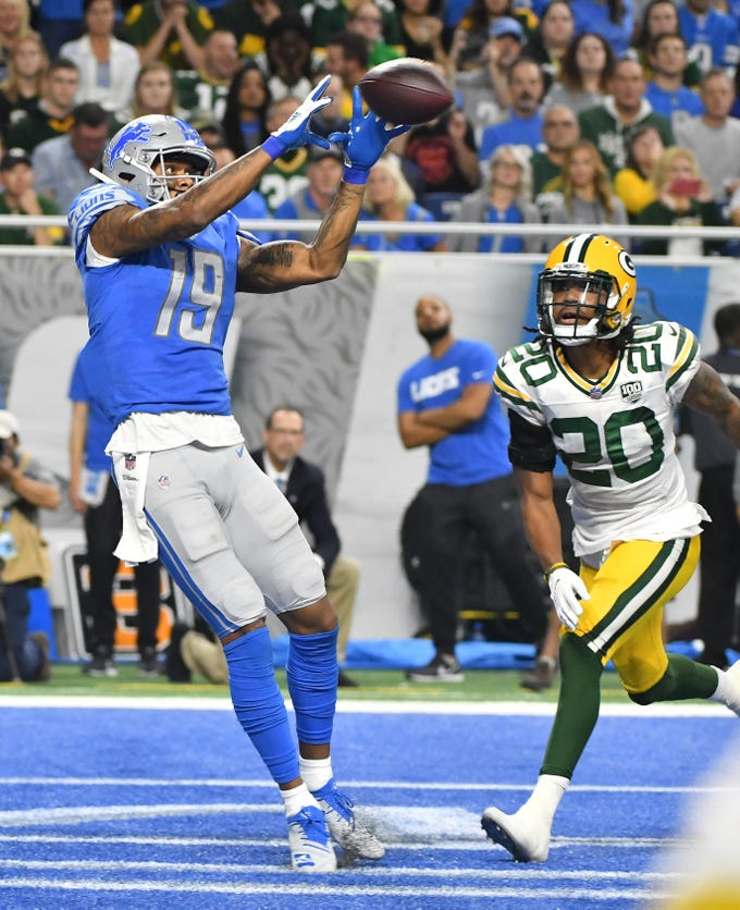 Lions wide receiver Kenny Golladay readies his hands for a touchdown reception in front of Green Bay Packers' Kevin King in the fourth quarter of the 31-23 Detroit victory at Ford Field in Detroit, Michigan on October 7, 2018.