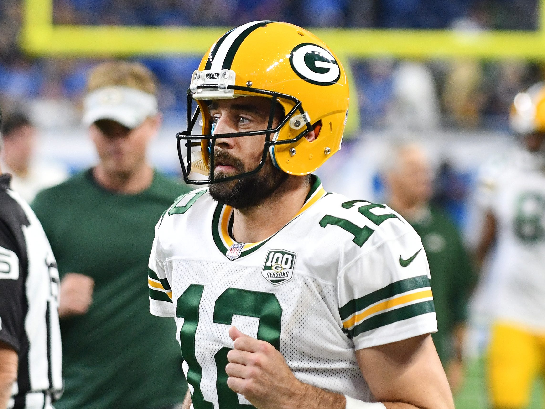 Packers quarterback Aaron Rodgers heads off the field after the warmups.