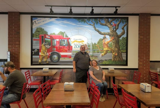 Mickey and Jan McKeel in front of our Firehouse's one-of-a-kind mural painted by Firehouse artist Joe Puskas, who has painted a personalized mural for each of the nearly 1,200 Firehouse Subs stores at Firehouse Subs on Friday, October 4, 2018.