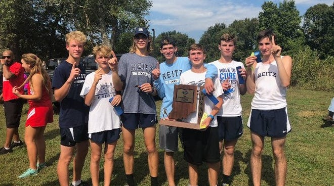 The Reitz High School cross country team celebrates its sectional win.