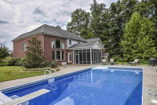 This custom built home on Evansville's west side has 20-foot vaulted ceilings, an entertainment/lounge area in the basement, saltwater pool and nearly 1.4 acres with lake views.