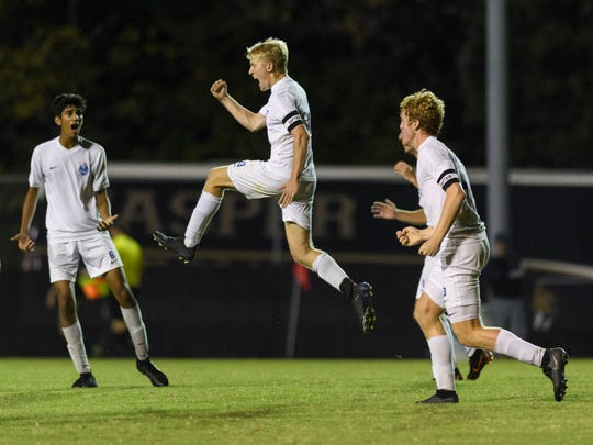 Castle's Patterson Edris (13), center, celebrates a goal made by teammate Brock Wandel (3), right, during the IHSAA Class 3A sectional championship against the Jasper Wildcats at Castle High School in Newburgh, Ind., Saturday, Oct. 6, 2018. The Knights defeated the Wildcats 1-0.