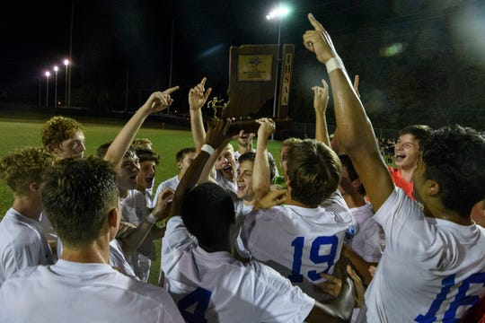 The Castle Knights celebrate their 1-0 victory over the Jasper Wildcats to become IHSAA Class 3A sectional champions at Castle High School in Newburgh, Ind., Saturday, Oct. 6, 2018.