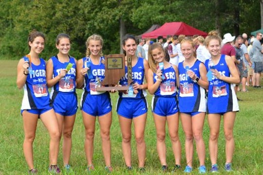 The Memorial High School girls' cross country team won the sectional.