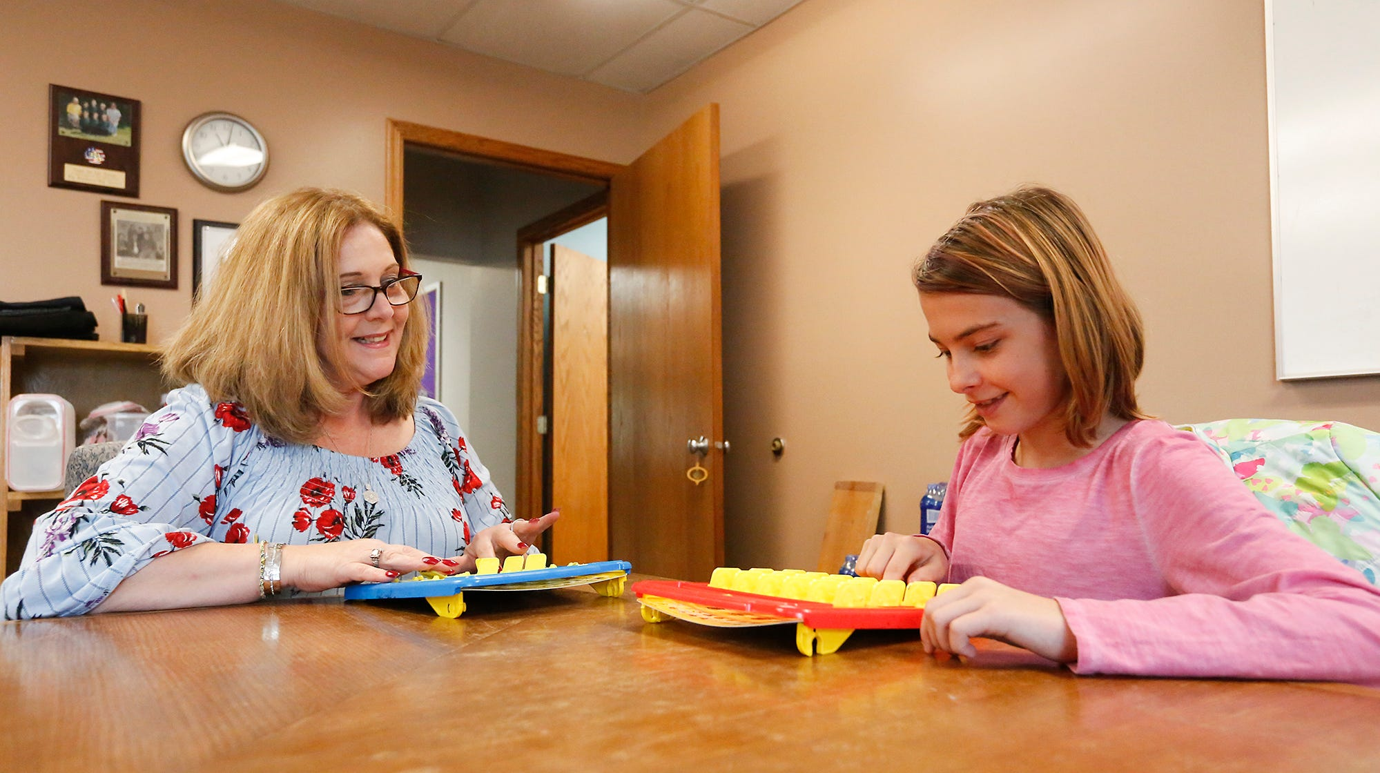 Joanne Schneider and Laila Nickerson of Fond du Lac play a game at the Big Brothers Big Sisters building in Fond du Lac.