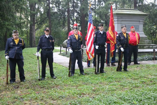 The Fremont VFW Post 2947's Honor Guard prepare for the precision of a 21-gun salute during a wreath-laying ceremony in honor of President Rutherford B. Hayes at his tomb on Sunday.