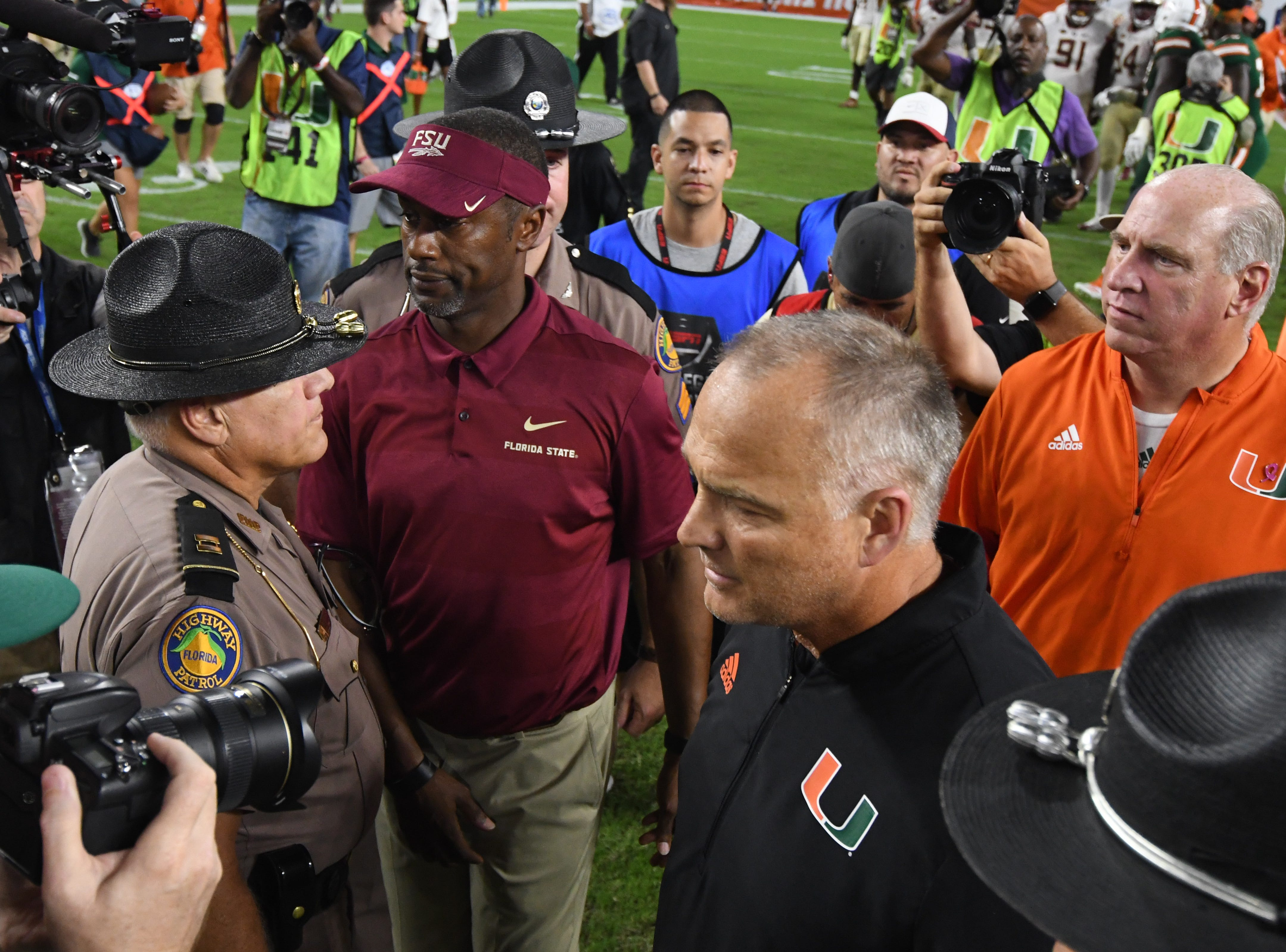 FSU head coach Willie Taggart meeting with Miami head coach Mark Richt after the FSU game against Miami at the Hard Rock Stadium on October 6th 2018.