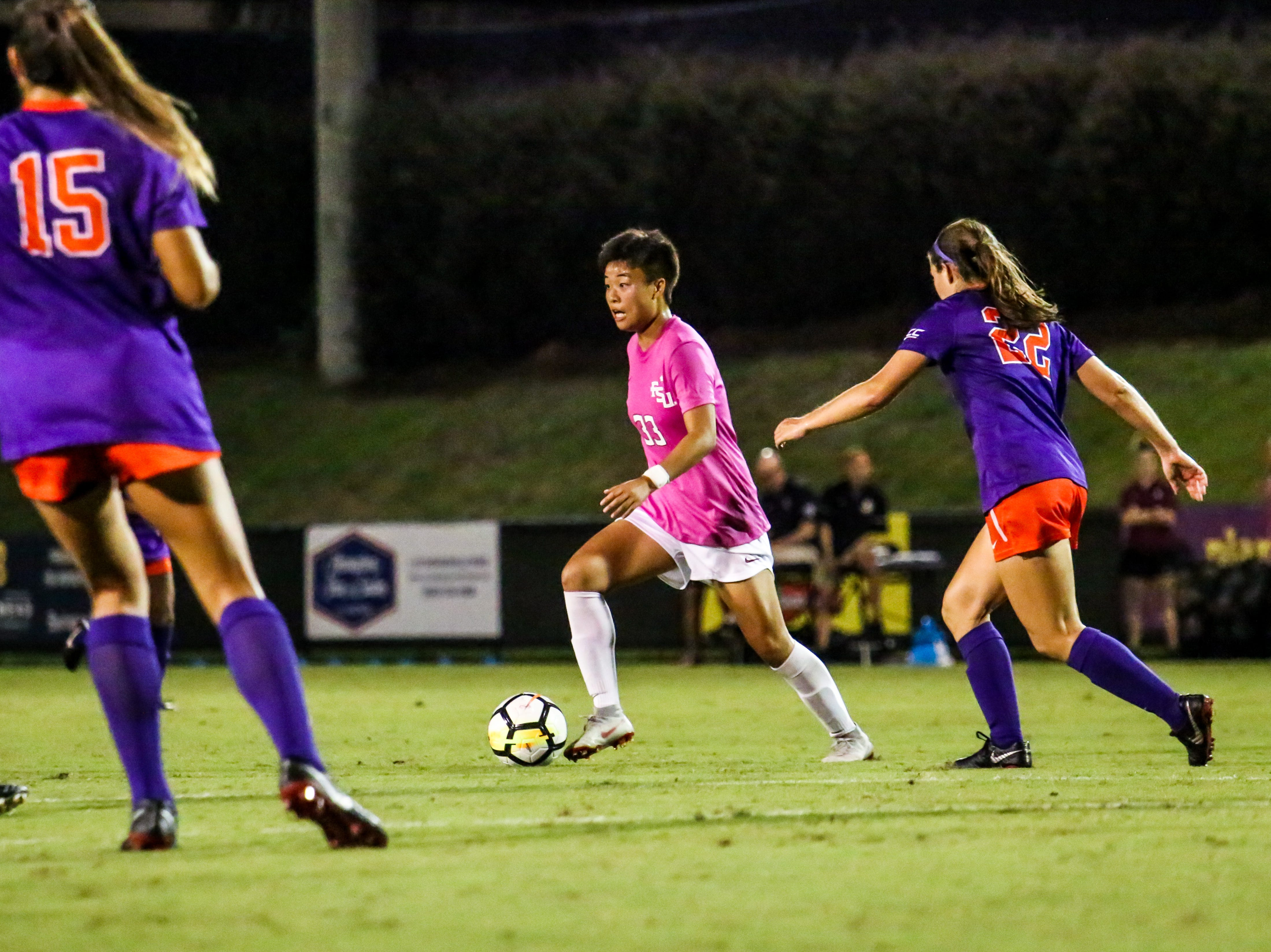 Yujie Zhao (33) was a workhorse in the midfield, providing many passes and through balls to teammates against Clemson on Thursday, October 4th at the Seminole Soccer Complex.
