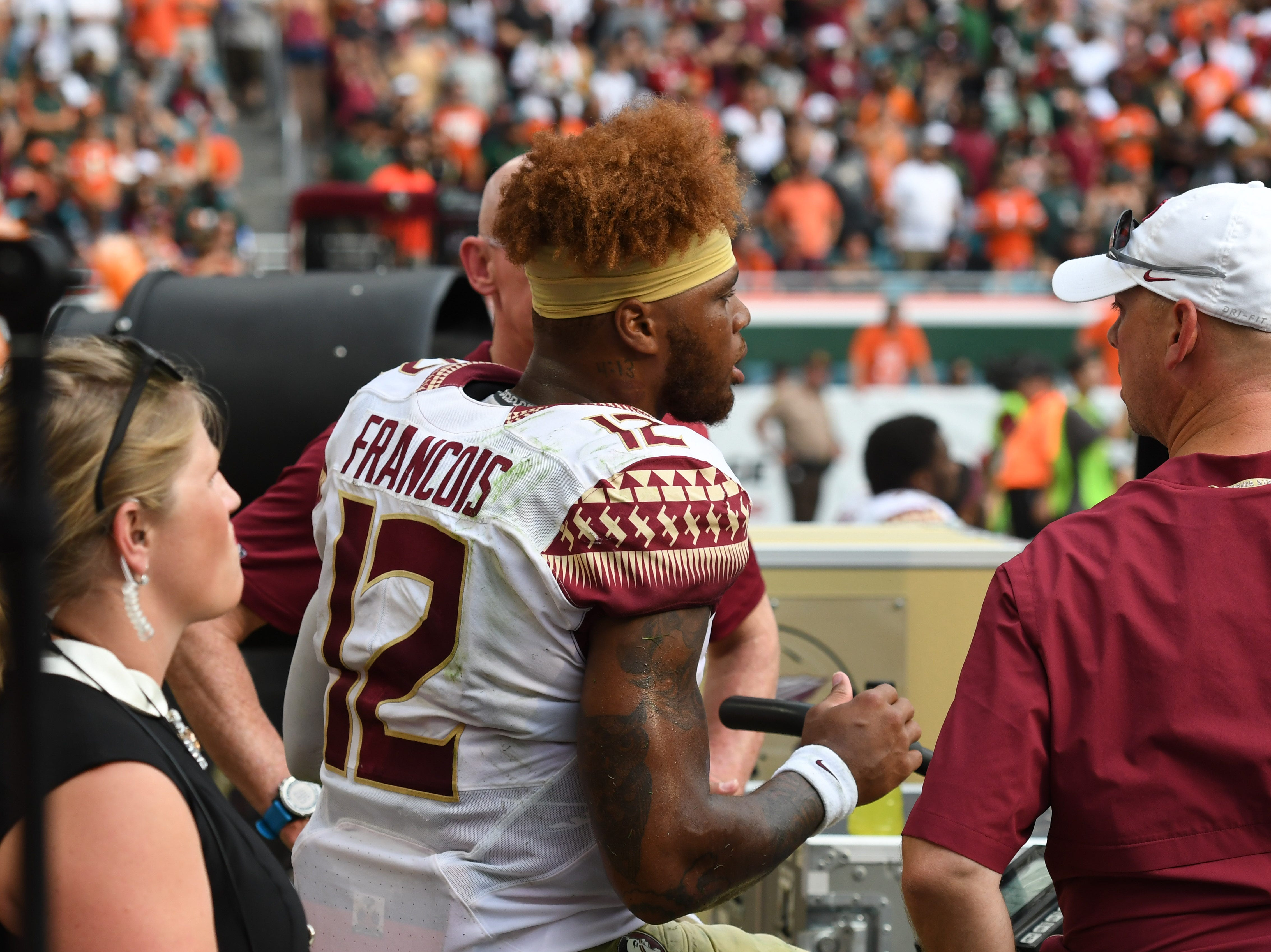 FSU redshirt junior quarterback Deondre Francois on the sideline after he was injured during a tackle in the second quarter of FSU's game against Miami at the Hard Rock Stadium on October 6th 2018.