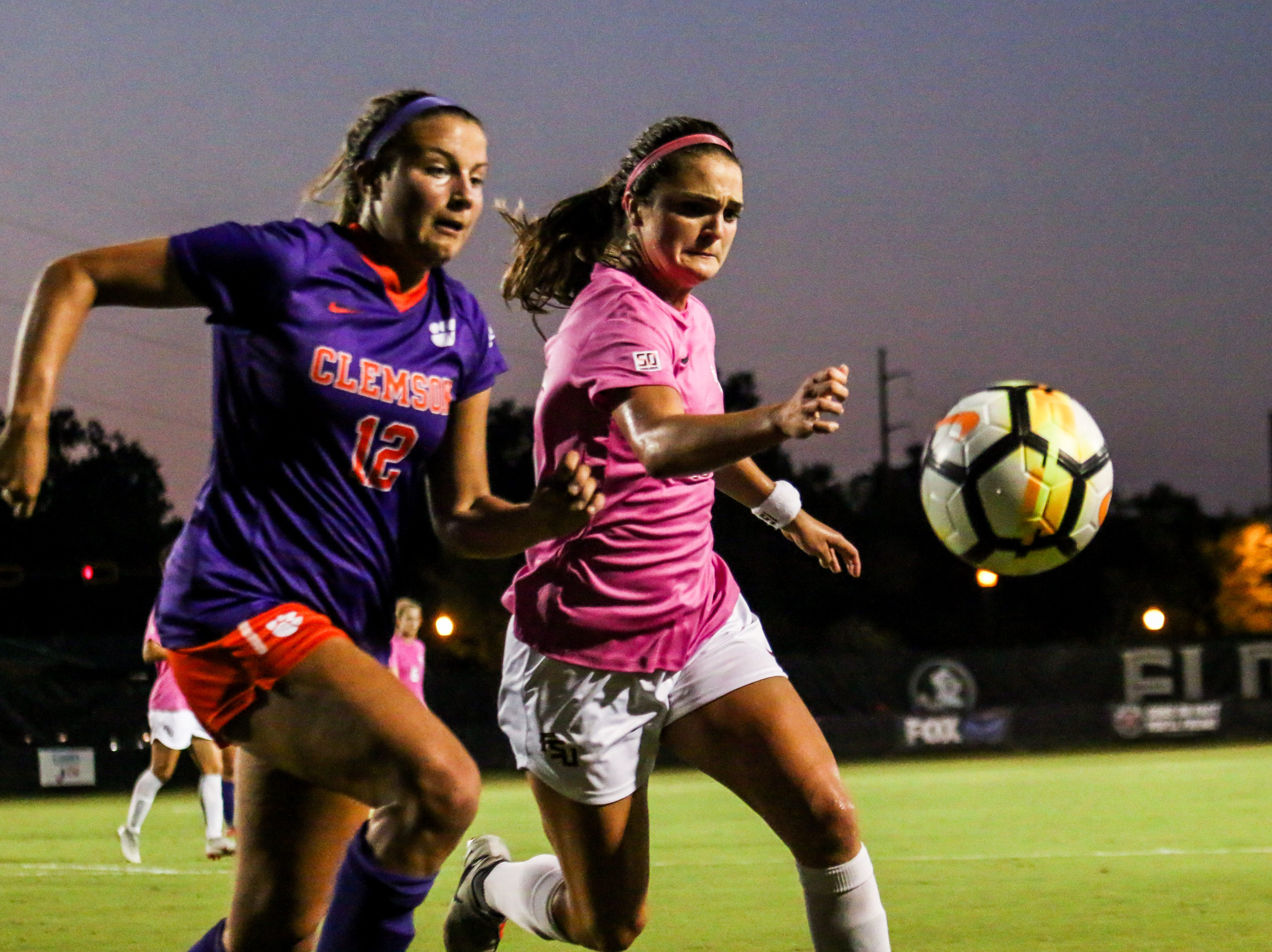Olivia Bergau (15) fights off a Clemson defender for possession in the first half on Thursday, October 4th at the Seminole Soccer Complex.