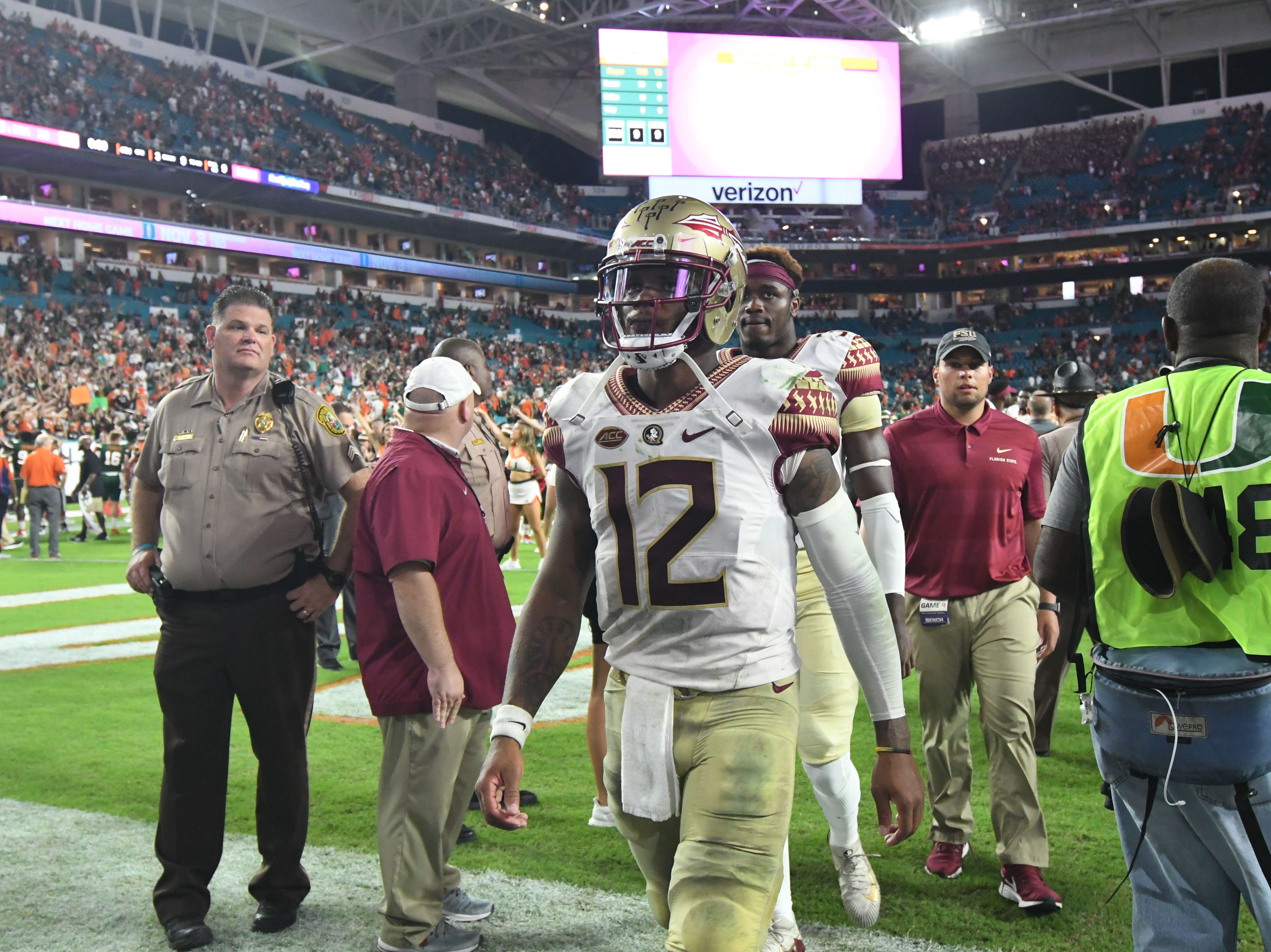 FSU redshirt junior quarterback Deondre Francois (12) walking off the field after losing to Miami 28-27 at the Hard Rock Stadium on October 6th 2018.