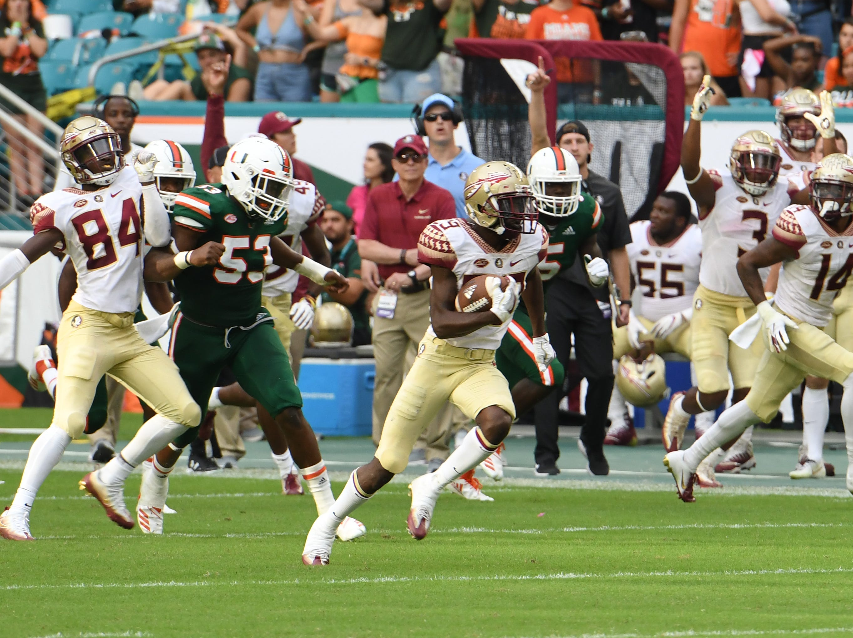 FSU sophomore punt returner DJ Matthews (29) returning a punt for a touchdown in the third quarter of FSU's game against Miami at the Hard Rock Stadium on October 6th 2018.