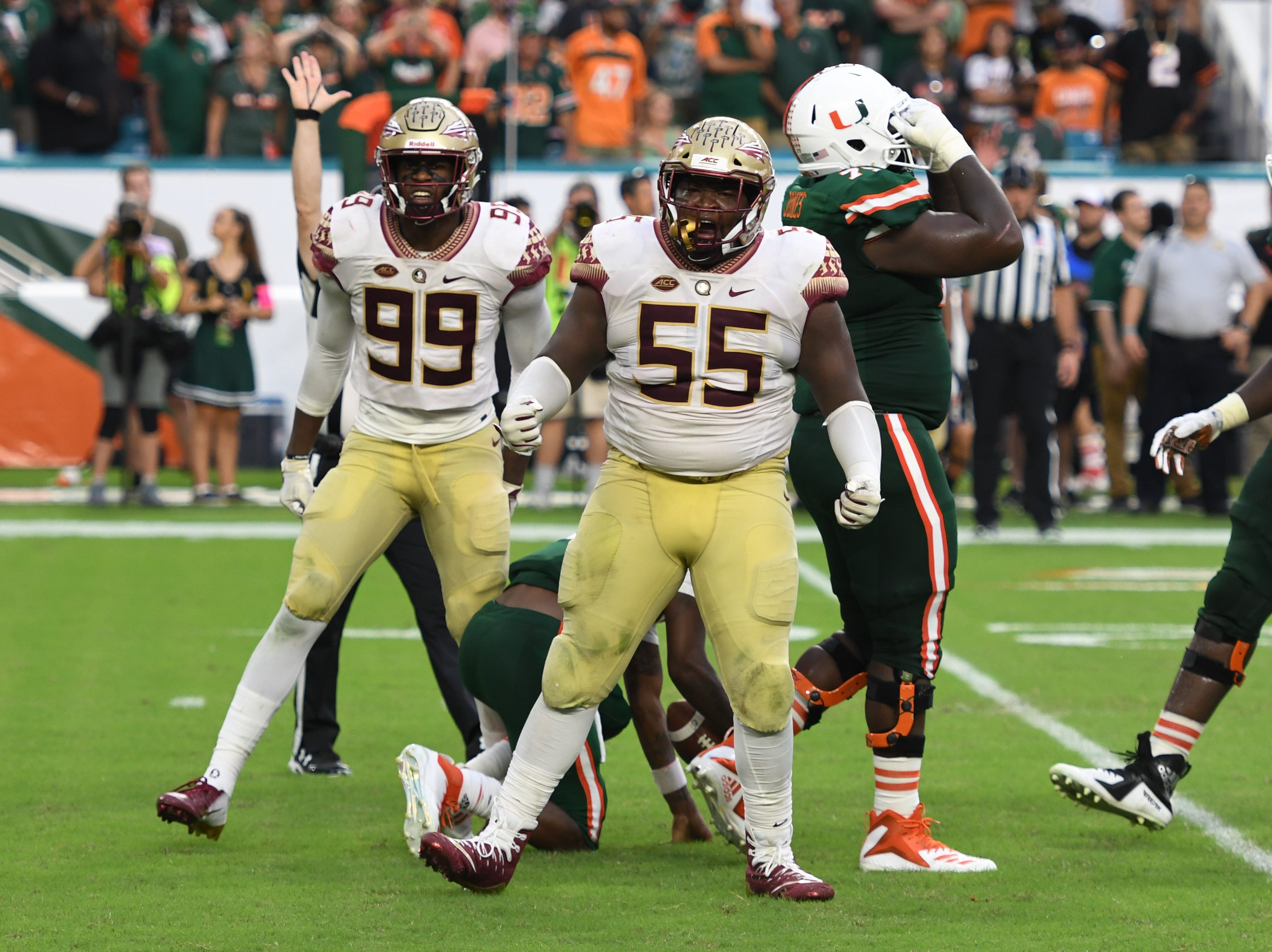 FSU redshirt senior nose guard Fredrick Jones (55) celebrating after sacking the quarterback in the fourth quarter of FSU's game against Miami at the Hard Rock Stadium on October 6th 2018.