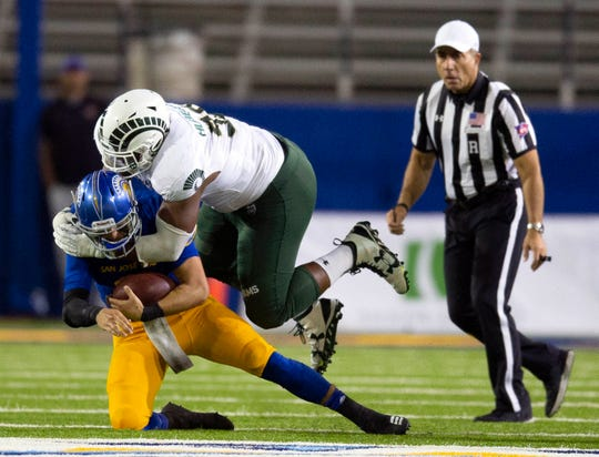 San Jose State quarterback Josh Love is sacked by Colorado State's Ellison Hubbard during the teams' game last season.