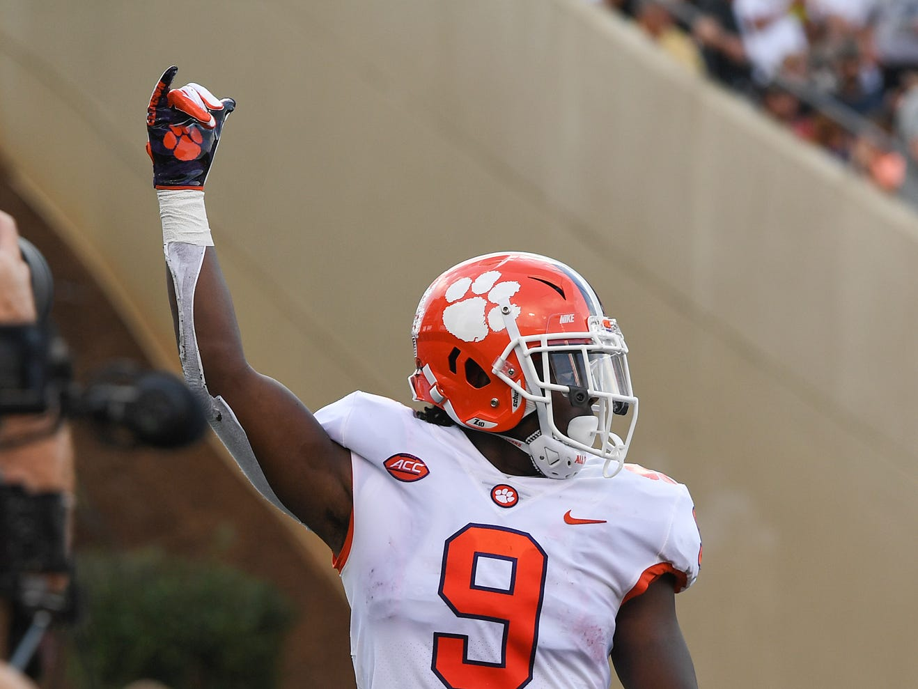 Clemson running back Travis Etienne (9) celebrates after racing 59 yards to score against Wake Forest during the 1st quarter at BB&T Field in Winston Salem, N.C. Saturday, October 6, 2018.