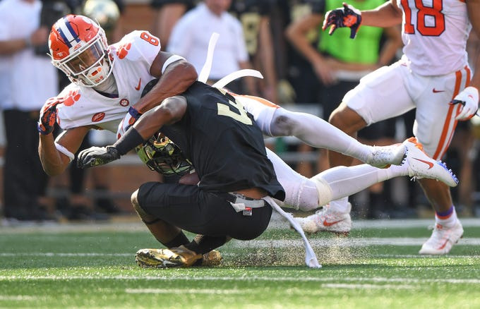 Clemson defensive back A.J. Terrell (8) brings down Wake Forest wide receiver Greg Dortch (3) during the 1st quarter at BB&T Field in Winston Salem, N.C. Saturday, October 6, 2018.