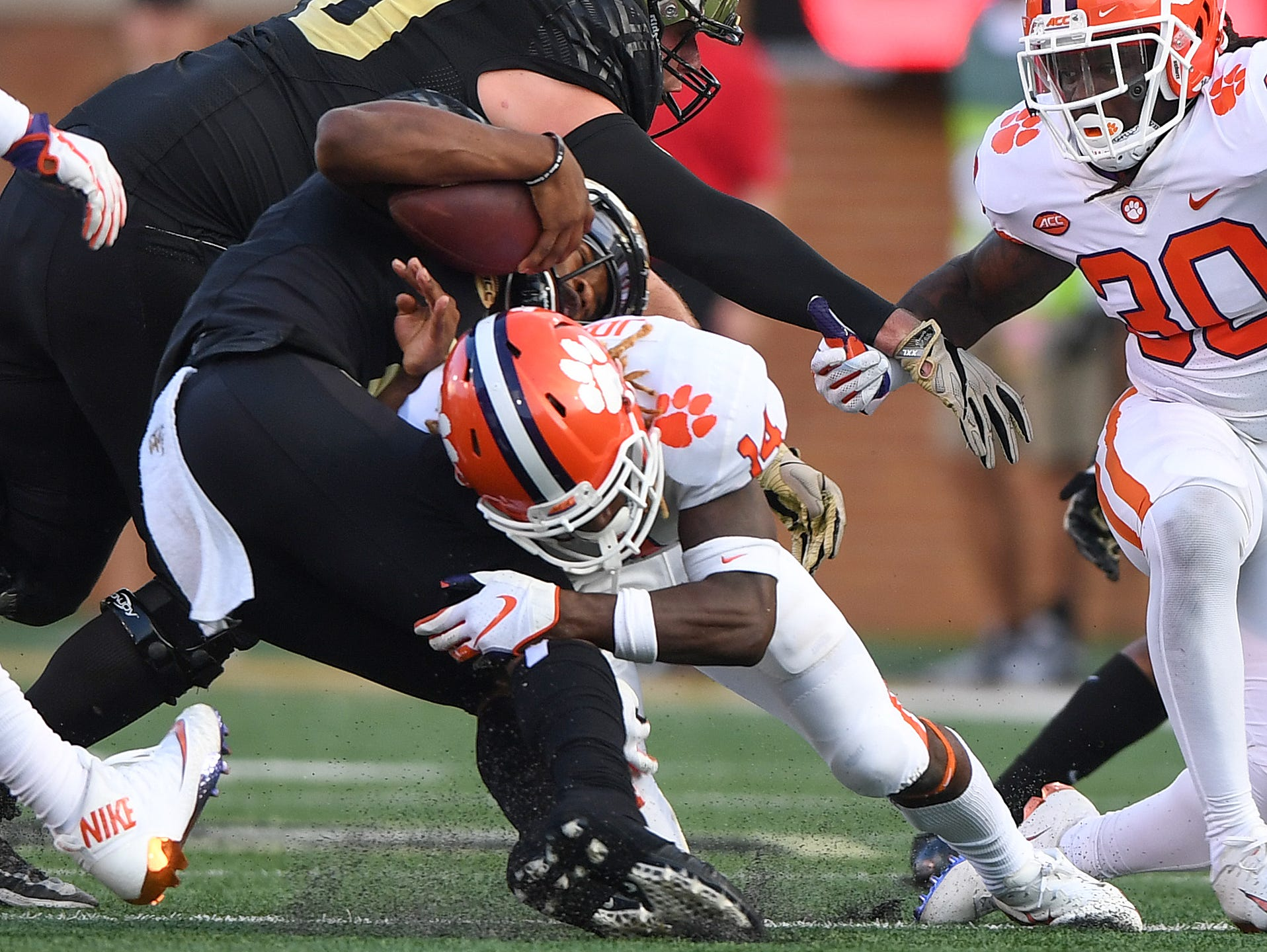 Clemson safety Denzel Johnson (14) brings down Wake Forest quarterback Kendall Hinton (2) during the 3rd quarter at BB&T Field in Winston Salem, N.C. Saturday, October 6, 2018.