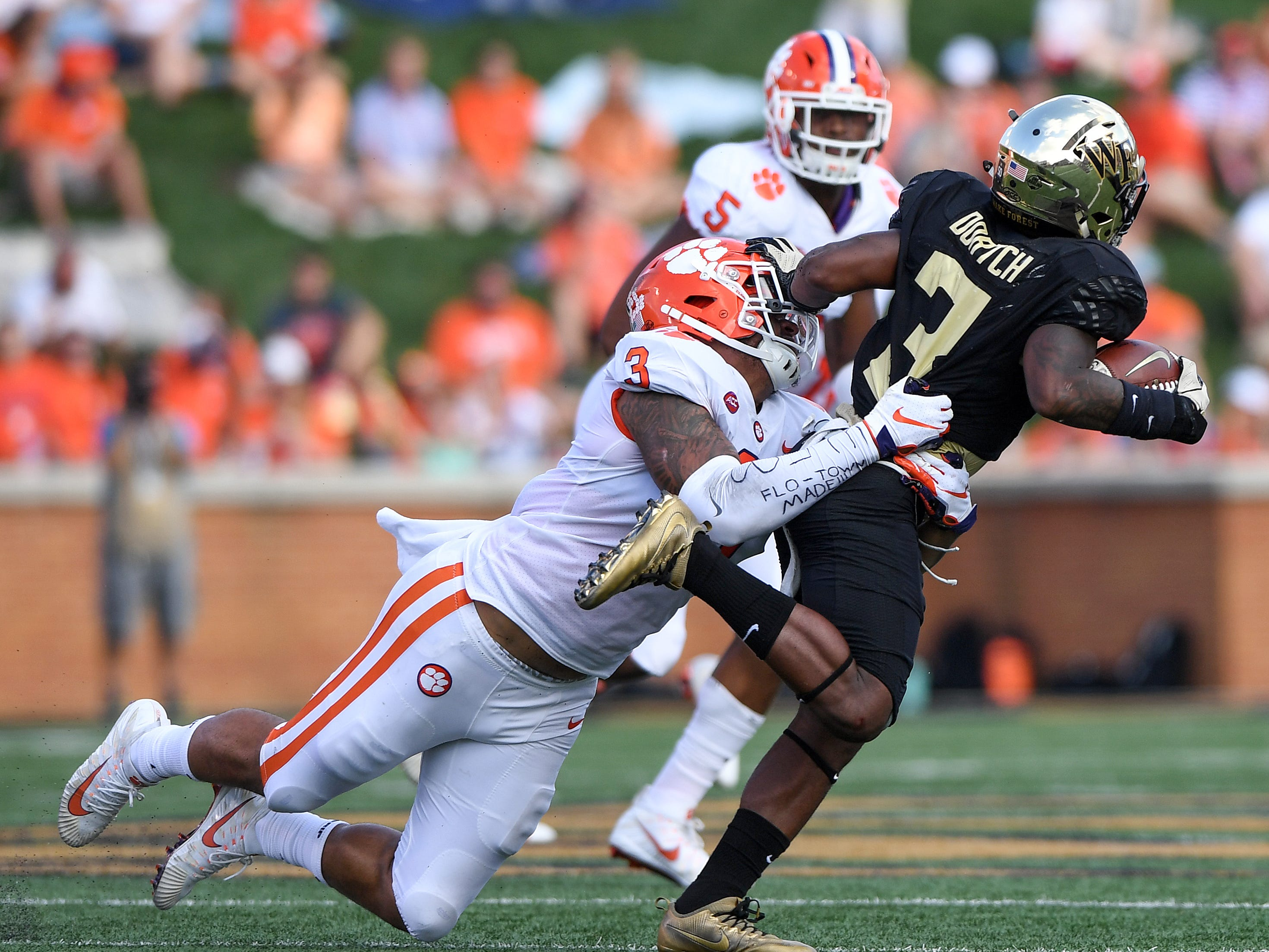 Clemson defensive lineman Xavier Thomas (3) brings down Wake Forest wide receiver Greg Dortch (3) during the 2nd quarter at BB&T Field in Winston Salem, N.C. Saturday, October 6, 2018.