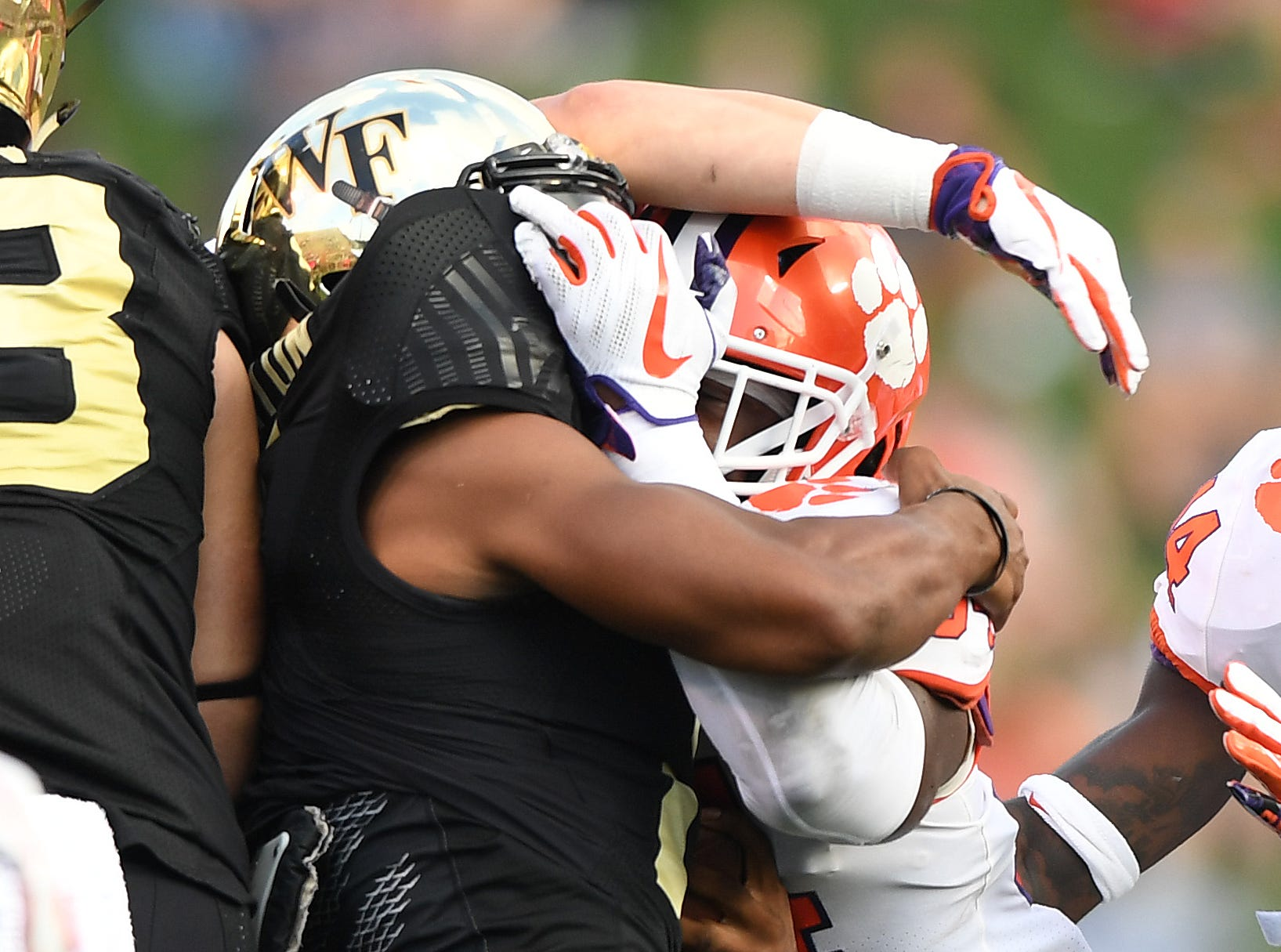 Clemson linebacker Kendall Joseph (34) brings down Wake Forest quarterback Kendall Hinton (2) during the 3rd quarter at BB&T Field in Winston Salem, N.C. Saturday, October 6, 2018.