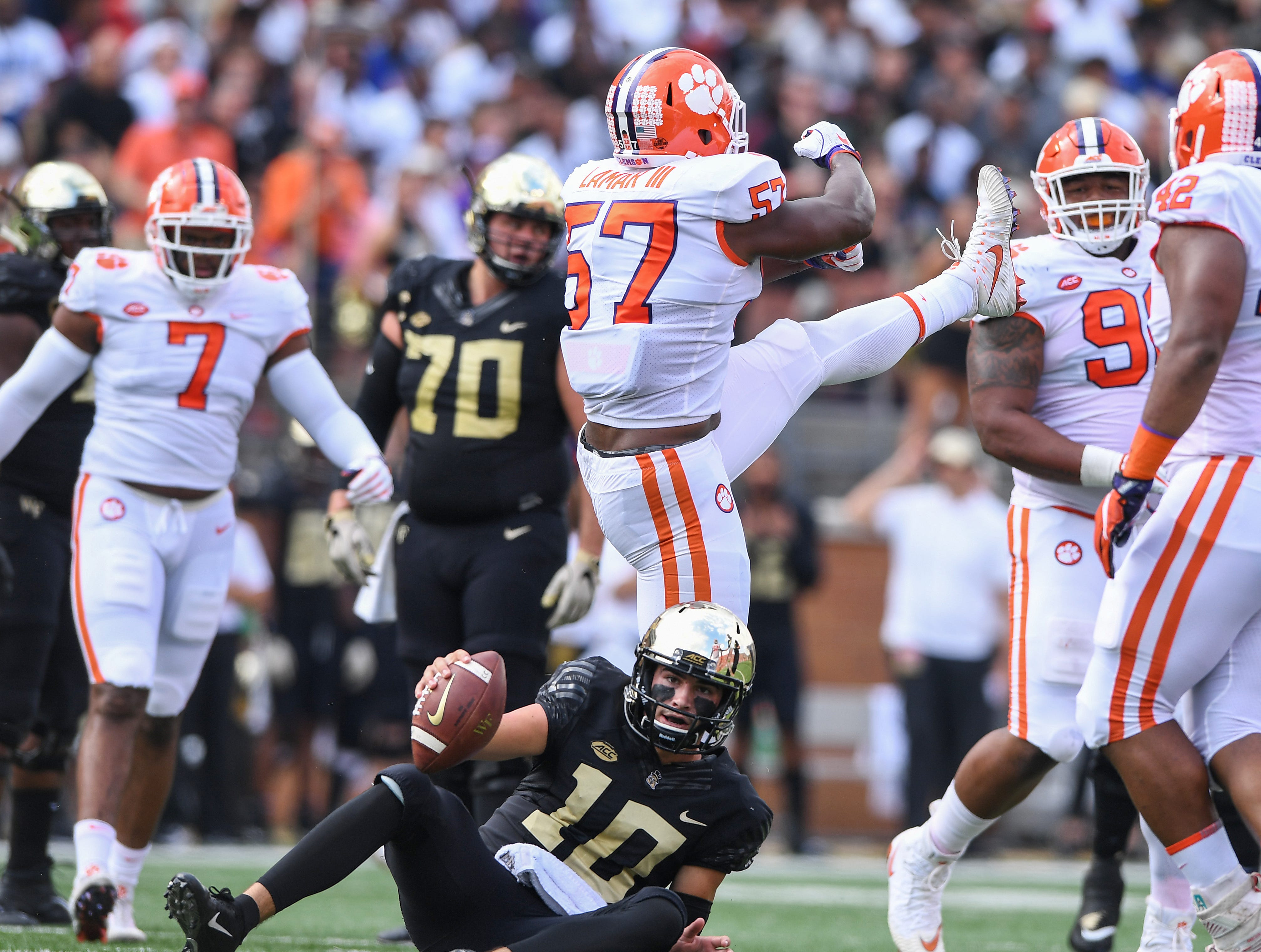 Clemson linebacker Tre Lamar (57) celebrates after sacking Wake Forest quarterback Sam Hartman (10) during the 1st quarter at BB&T Field in Winston Salem, N.C. Saturday, October 6, 2018.