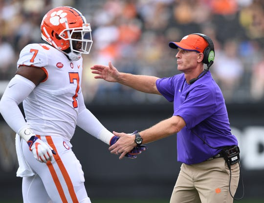 Clemson defensive coordinator Brent Venables congratulates defensive lineman Austin Bryant (7) after a defensive stop against Wake Forest during the 1st quarter at BB&T Field in Winston Salem, N.C. Saturday, October 6, 2018.