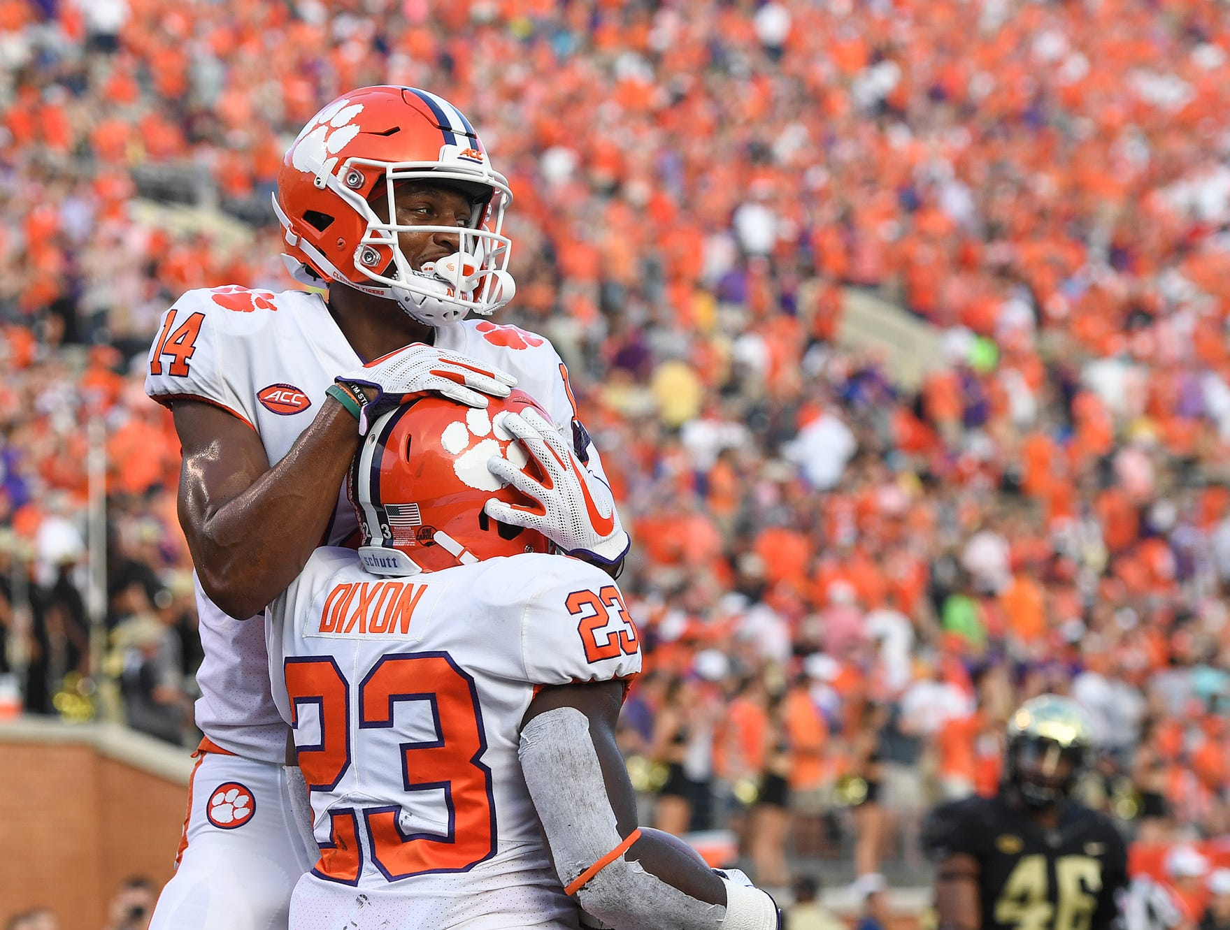 Clemson running back Lyn-J Dixon (23) celebrates with teammate wide receiver Diondre Overton (14) after scoring against Wake Forest during the 3rd quarter at BB&T Field in Winston Salem, N.C. Saturday, October 6, 2018.