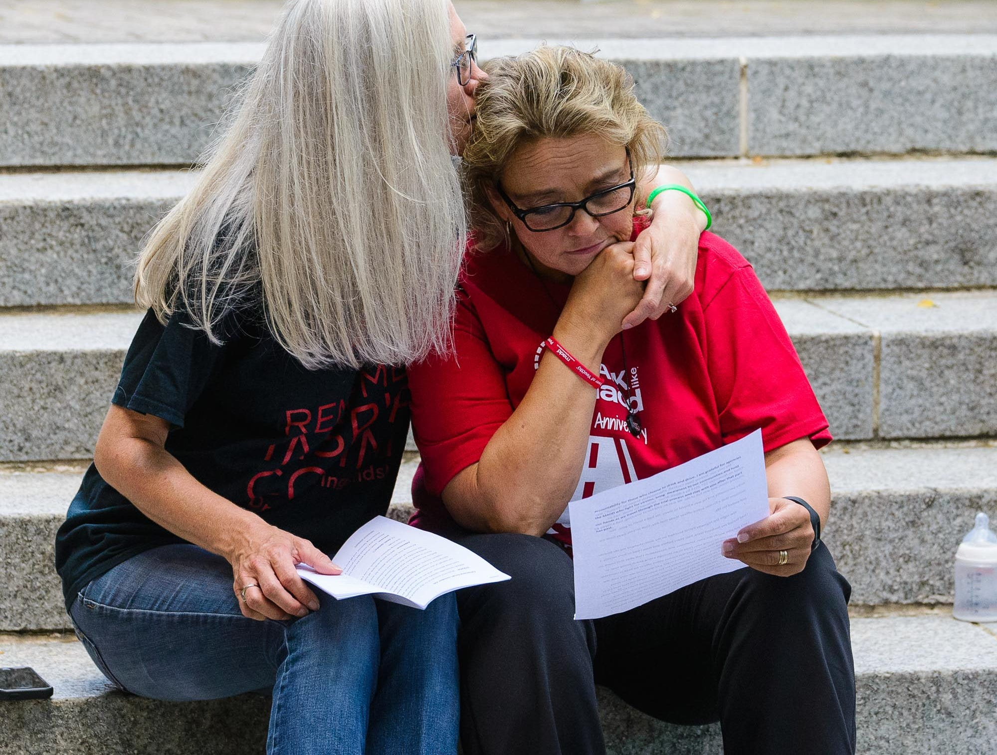 Rhonda Cockrell (right) is consoled moment before she takes to the microphone to tell the story of her son Jeremy at the 2nd annual Walk Like MADD  Greenville Upstate fundraiser and 5K walk at Clemson's Internation Center for Automotive Research on Sunday, October 7, 2018.