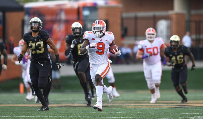 Clemson running back Travis Etienne (9) races 59 yards to score against Wake Forest during the 1st quarter at BB&T Field in Winston Salem, N.C. Saturday, October 6, 2018.