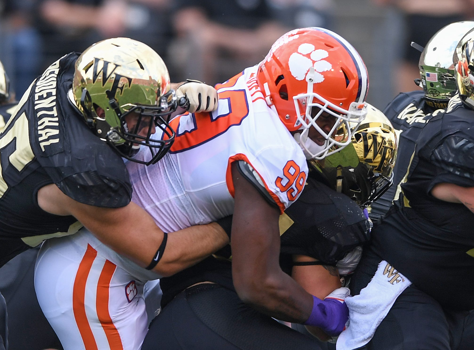 Clemson defensive lineman Clelin Ferrell (99) tackles Wake Forest running back Cade Carney (36) during the 1st quarter at BB&T Field in Winston Salem, N.C. Saturday, October 6, 2018.