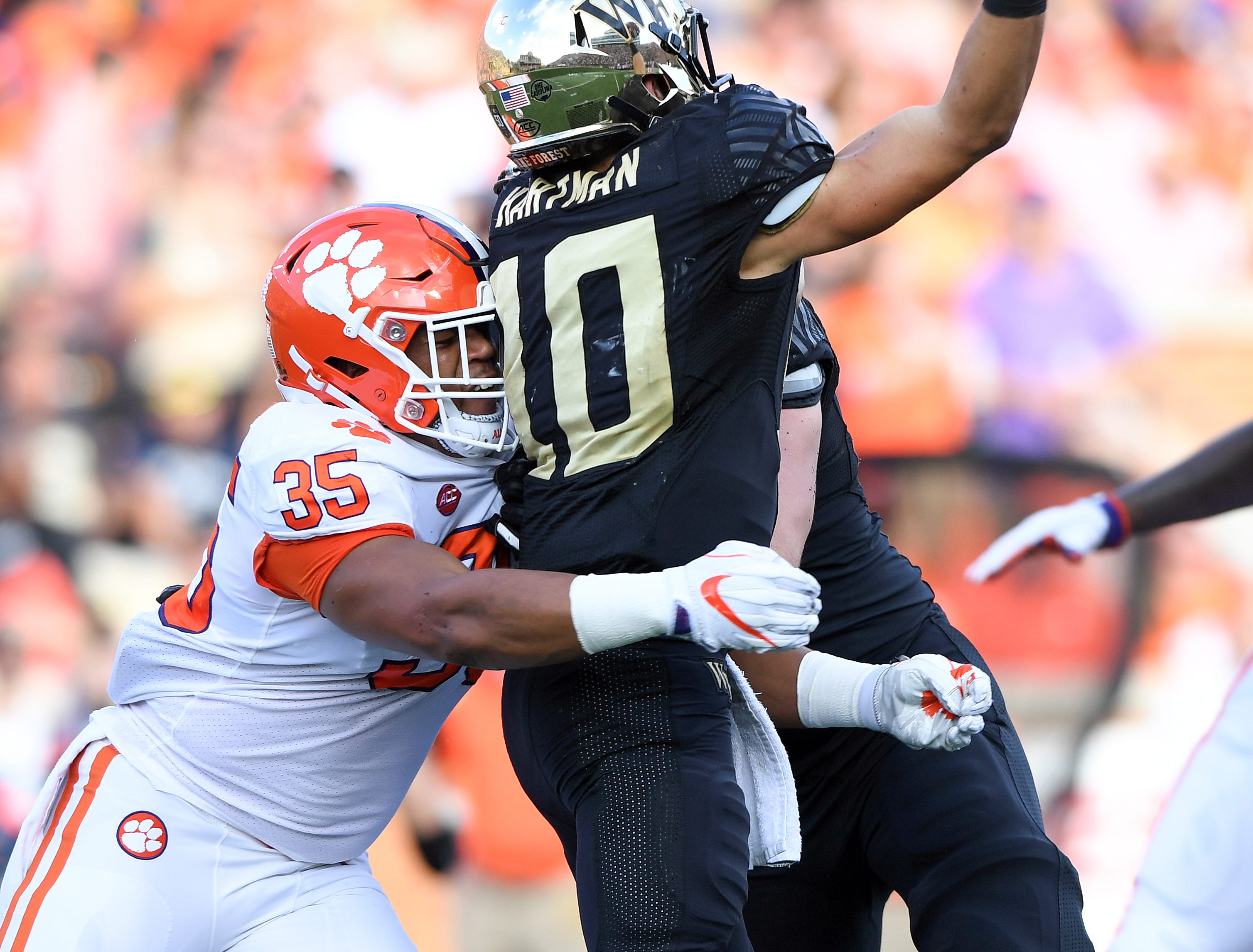 Clemson linebacker Justin Foster (35) pressures Wake Forest quarterback Sam Hartman (10) during the 2nd quarter at BB&T Field in Winston Salem, N.C. Saturday, October 6, 2018.