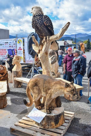 In this Sunday, Sept. 24, 2018 photo, the winning piece by competition winner Joe Dussia is displayed during the auction at the Kootenai Country Montana Chainsaw Carving Championship in Libby, Mont. (Ben Kibbey/The Western News)