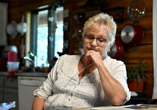 "Sitting in her home on the Kootenai River outside Libby, Montana, on September 13, Gayla Benefield, 75, reflects on the past two decades since she became active in exposing the asbestos disaster in and around Libby. Both her parents died of asbestos-related disease, her husband died three years ago of lung cancer, and she and four of her five adult children have been diagnosed. ""I'm almost numb to losing people now,"" she says. (Kurt Wilson/The Missoulian via AP)"