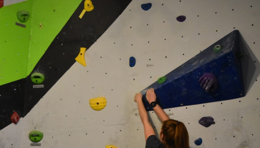 Competitors utilize holds along their route.
