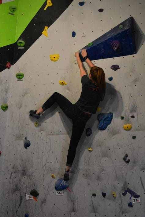 Climbing Competitors Utilize The Holds Along Their Route